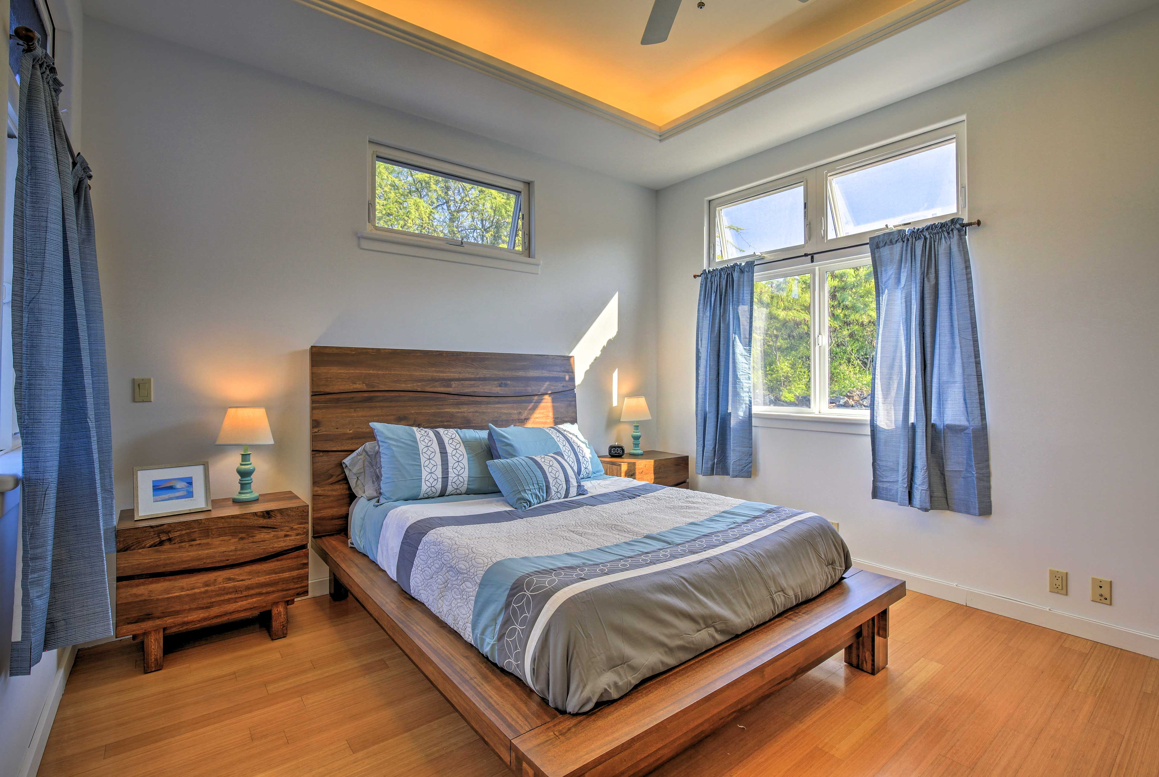 The bedroom is equipped with a comfortable queen-sized bed.