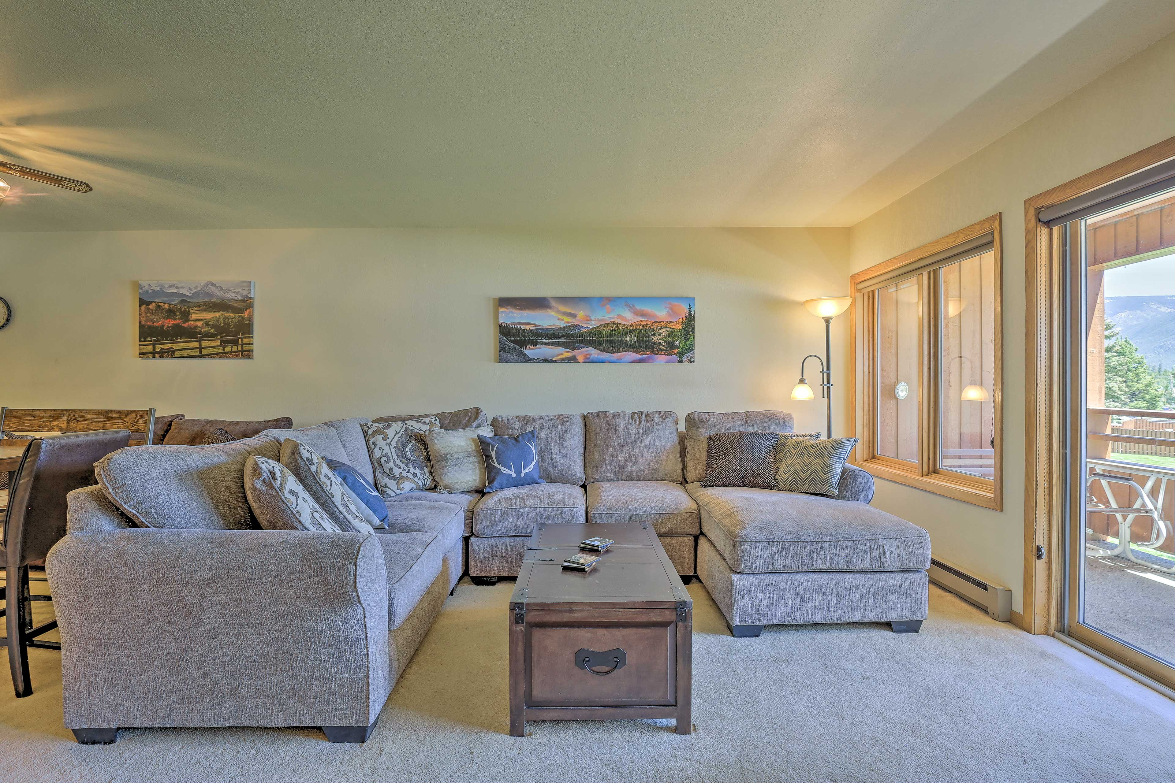 The large sliding glass doors offer great views of the area.