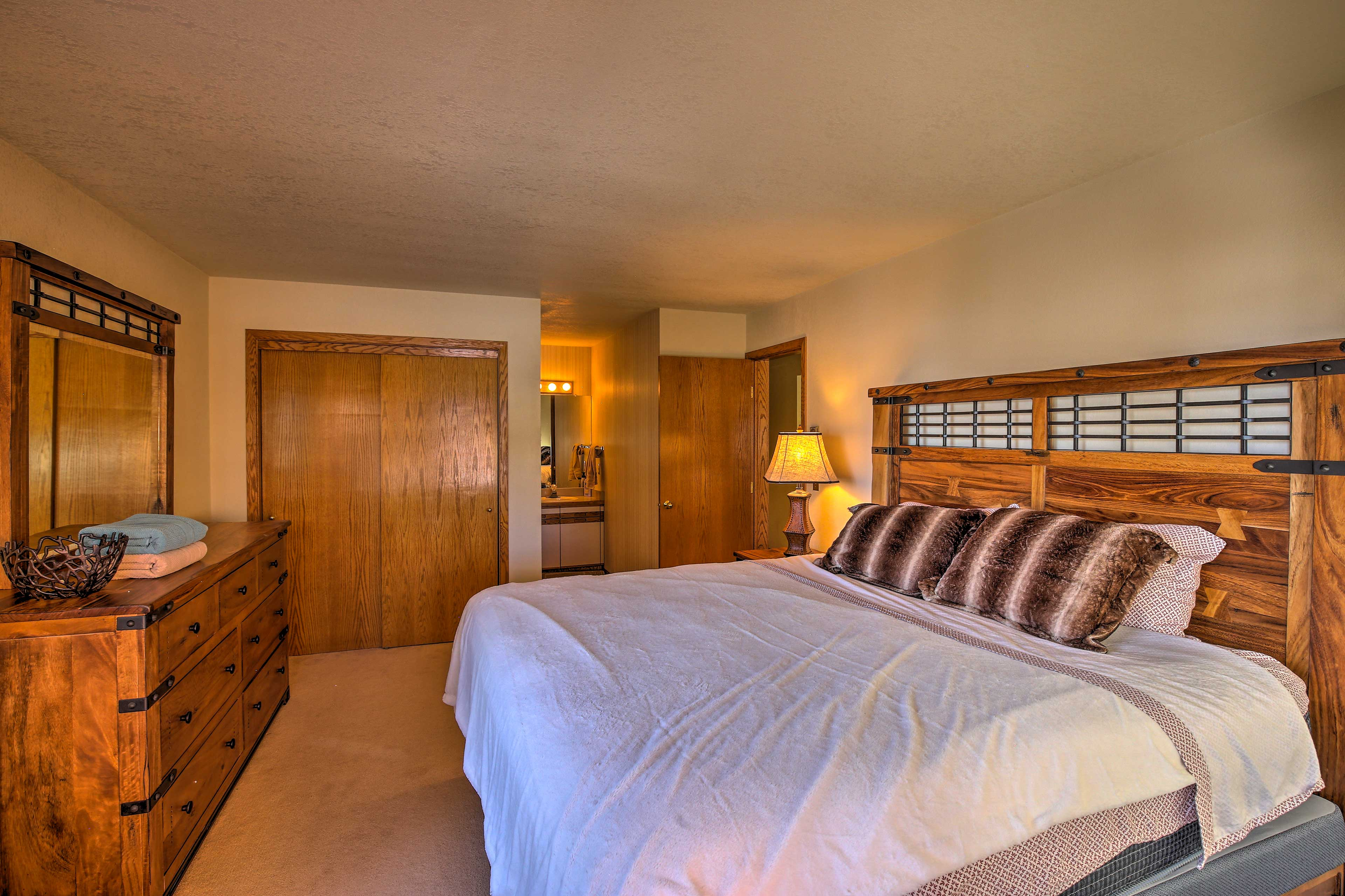 The master bedroom offers a plush king bed.