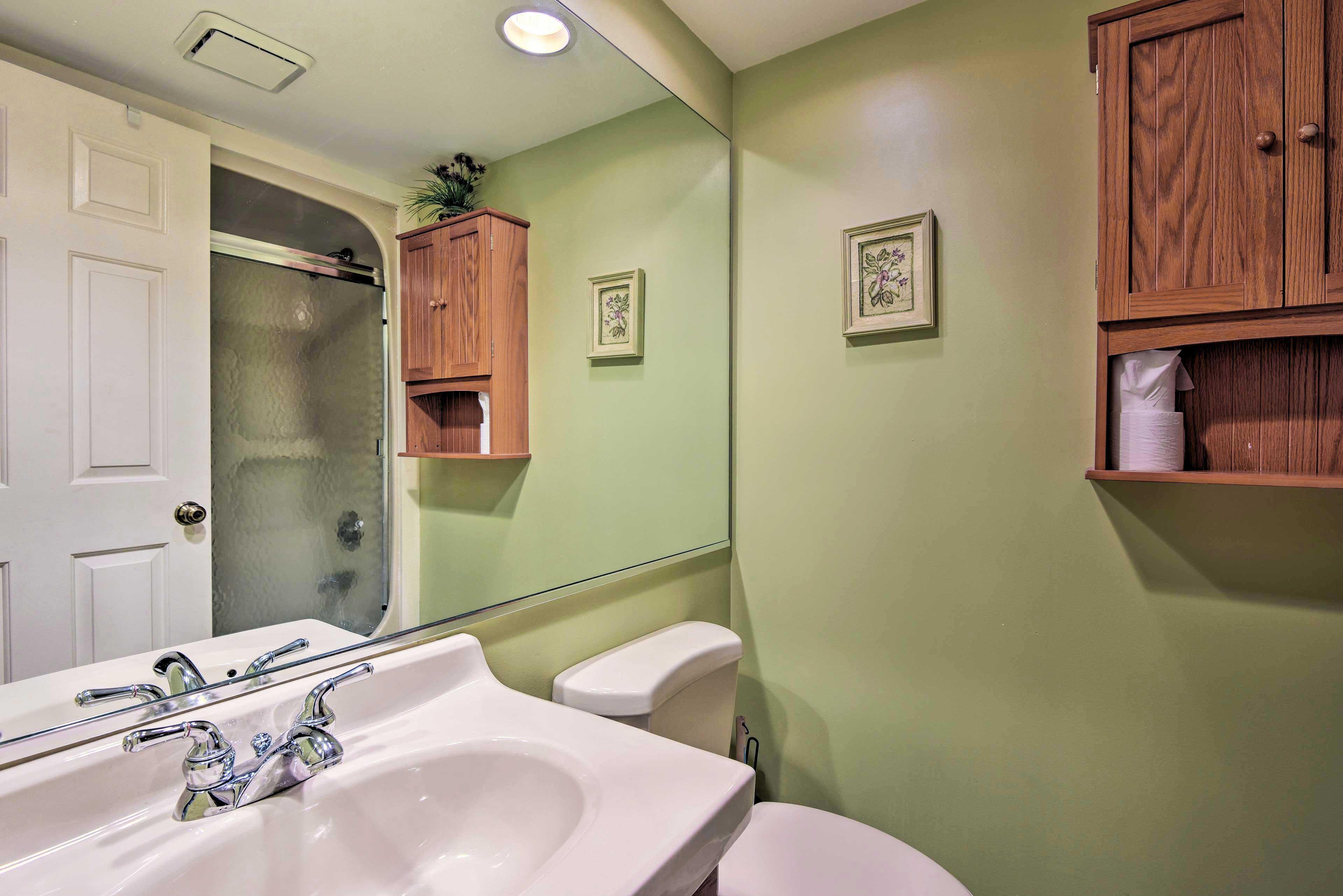 The en-suite bathroom features a shower/tub combo.