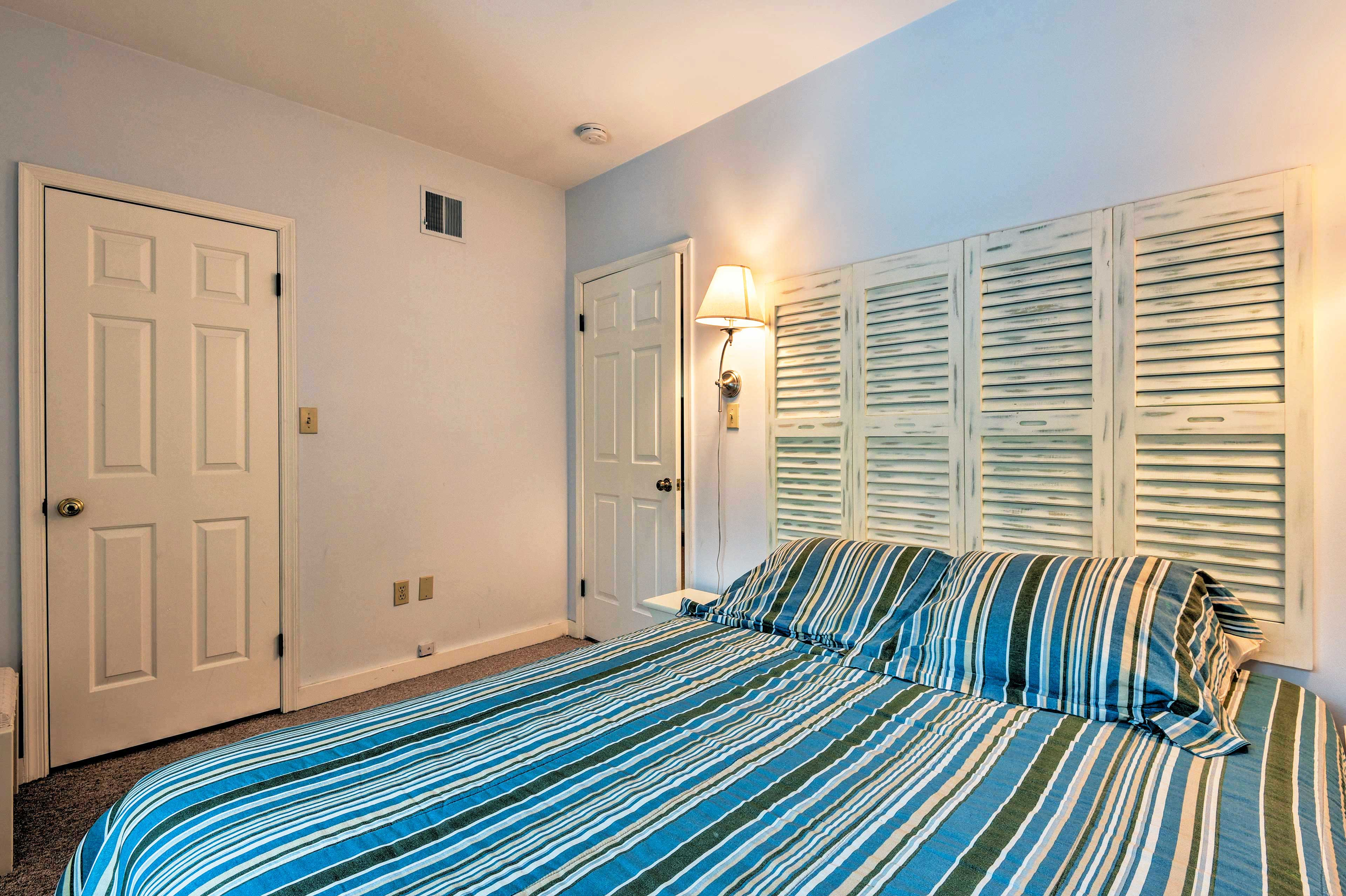 A queen-sized bed highlights the third bedroom.