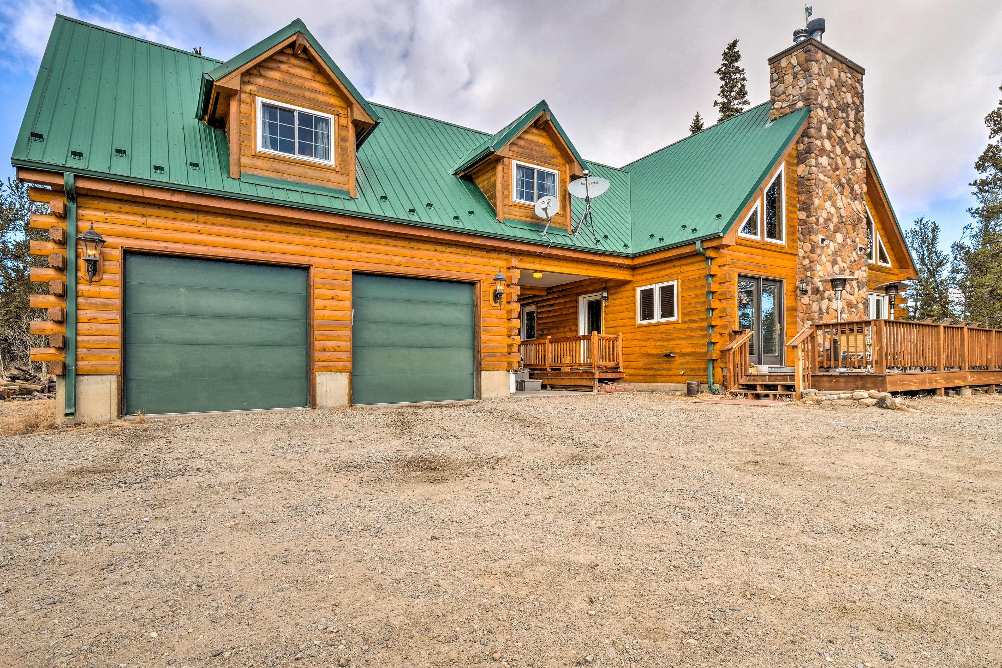 Dive into nature at 'High Creek Hideaway,' a 5-bed, 3-bath vacation rental.