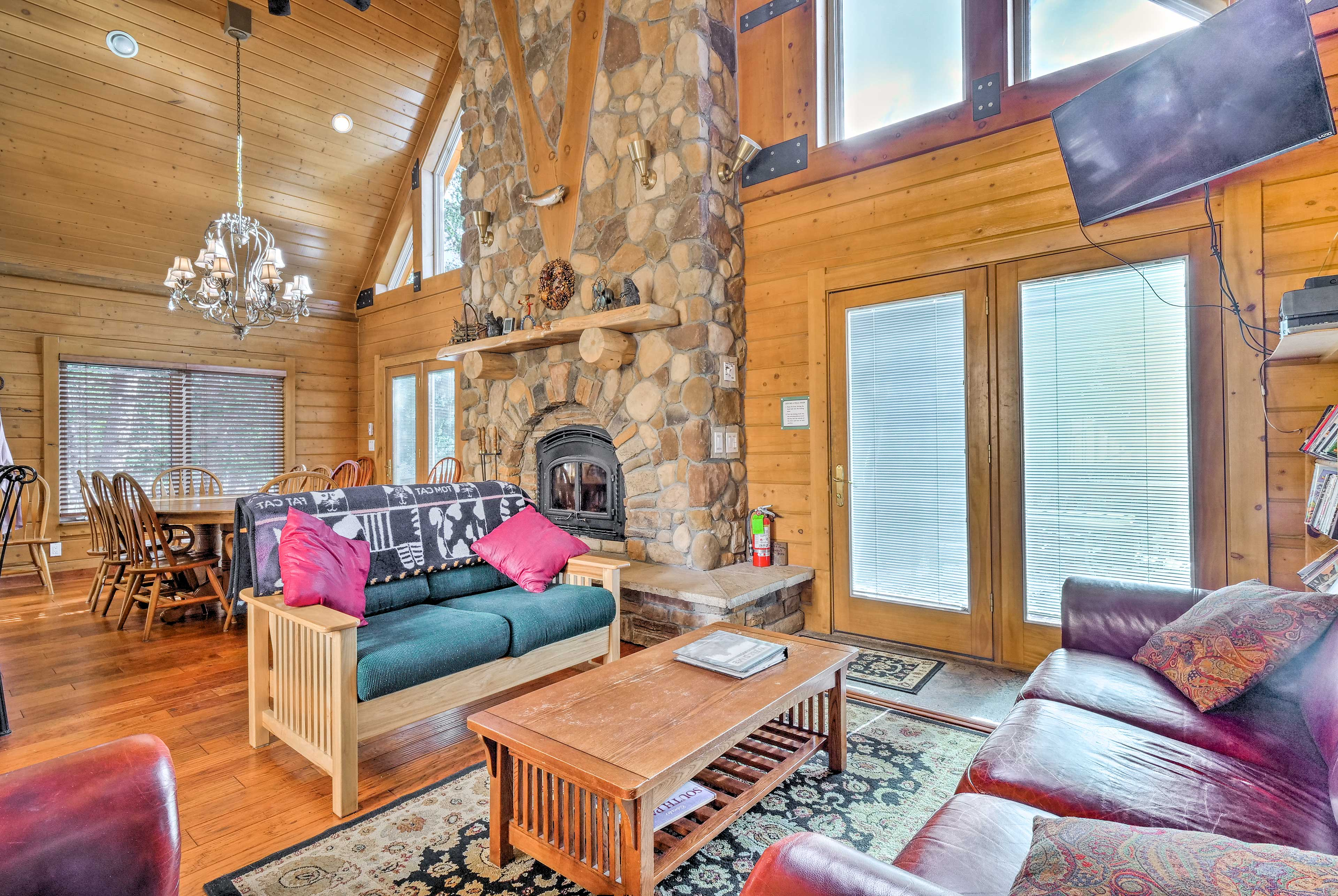 A stunning river rock fireplace serves as the room's focal point.