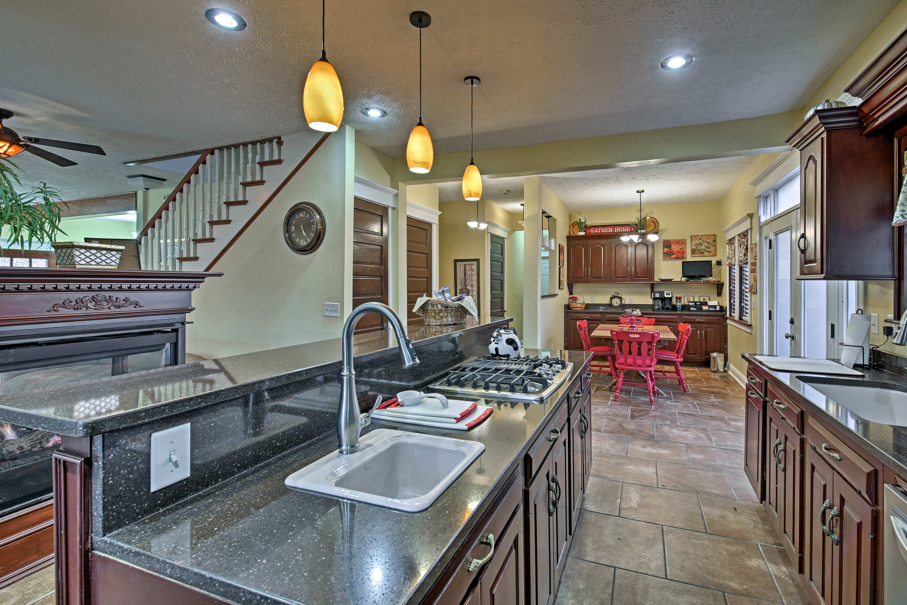 The kitchen features new, stainless steel appliances.