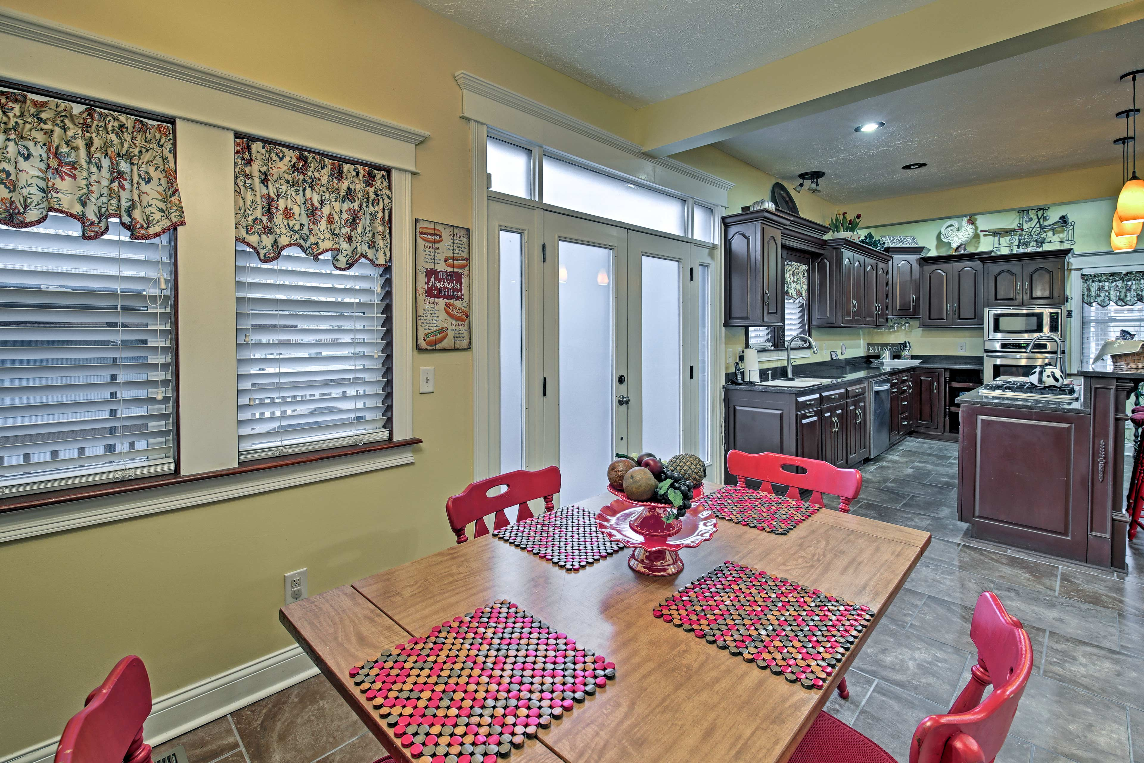 A table adjacent to the kitchen is perfect for enjoying a quick meal.