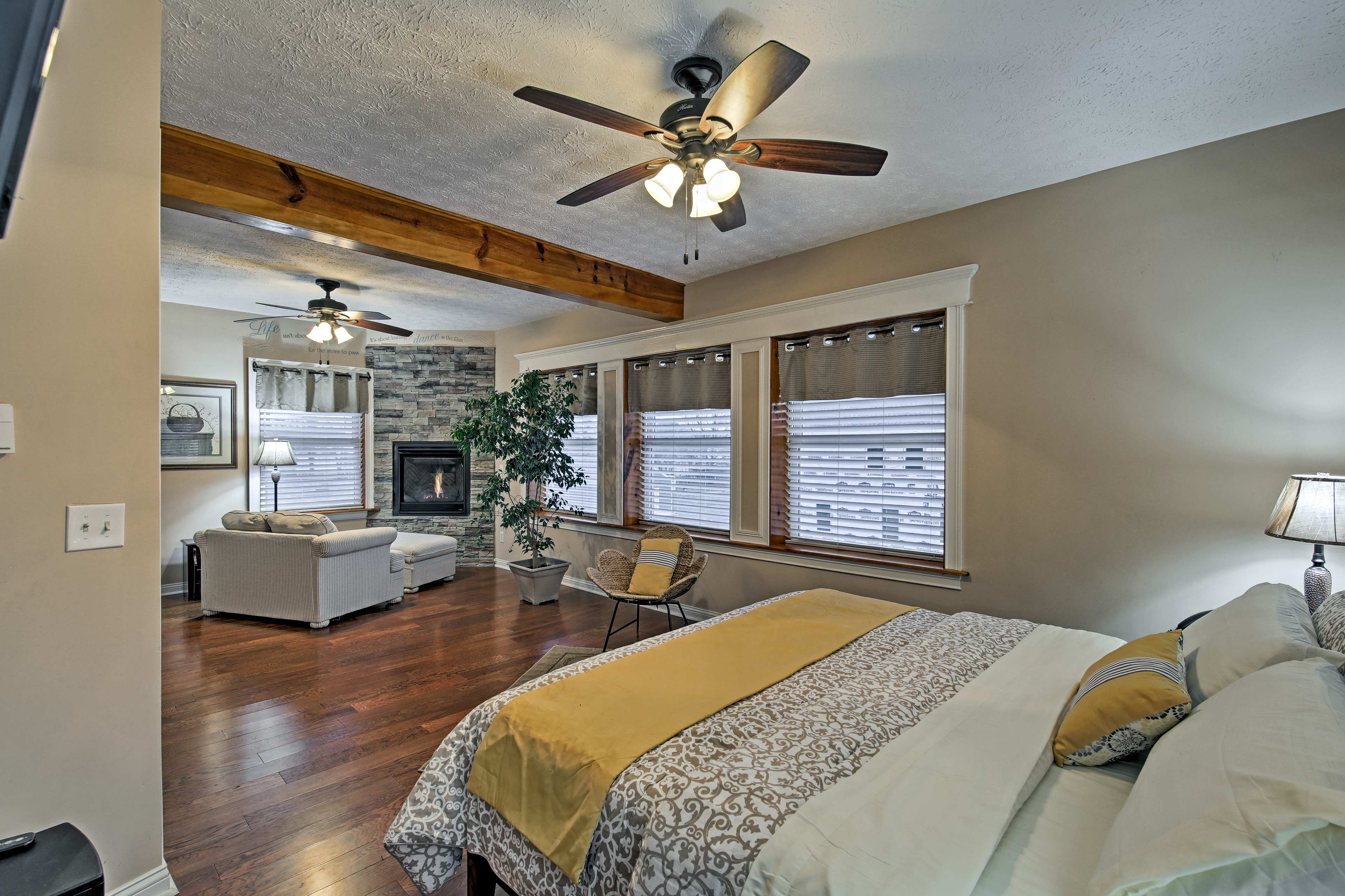 The master bedroom hosts a king bed, fireplace, and seating area.