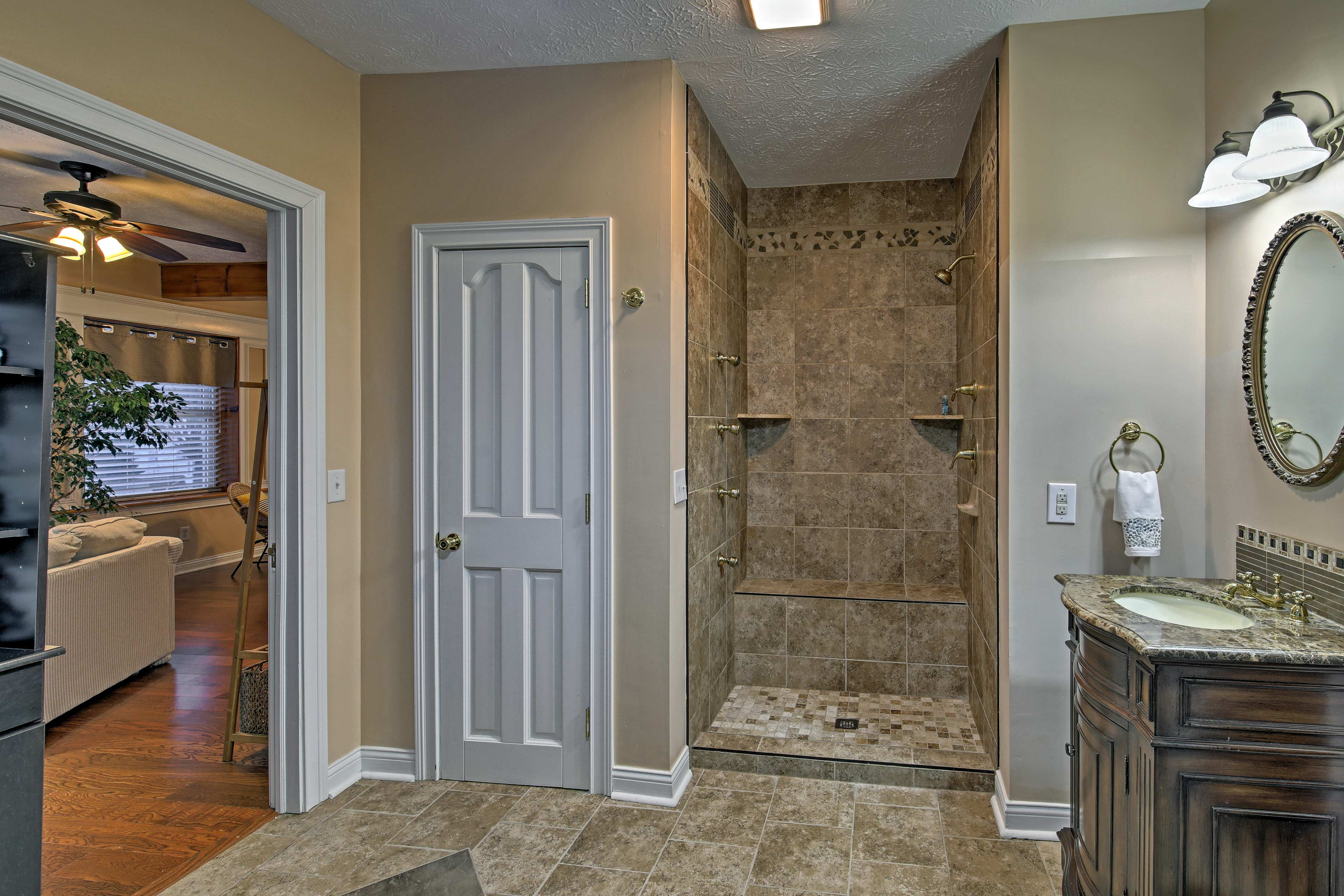 The walk-in shower in the en-suite bathroom is the epitome of luxury.