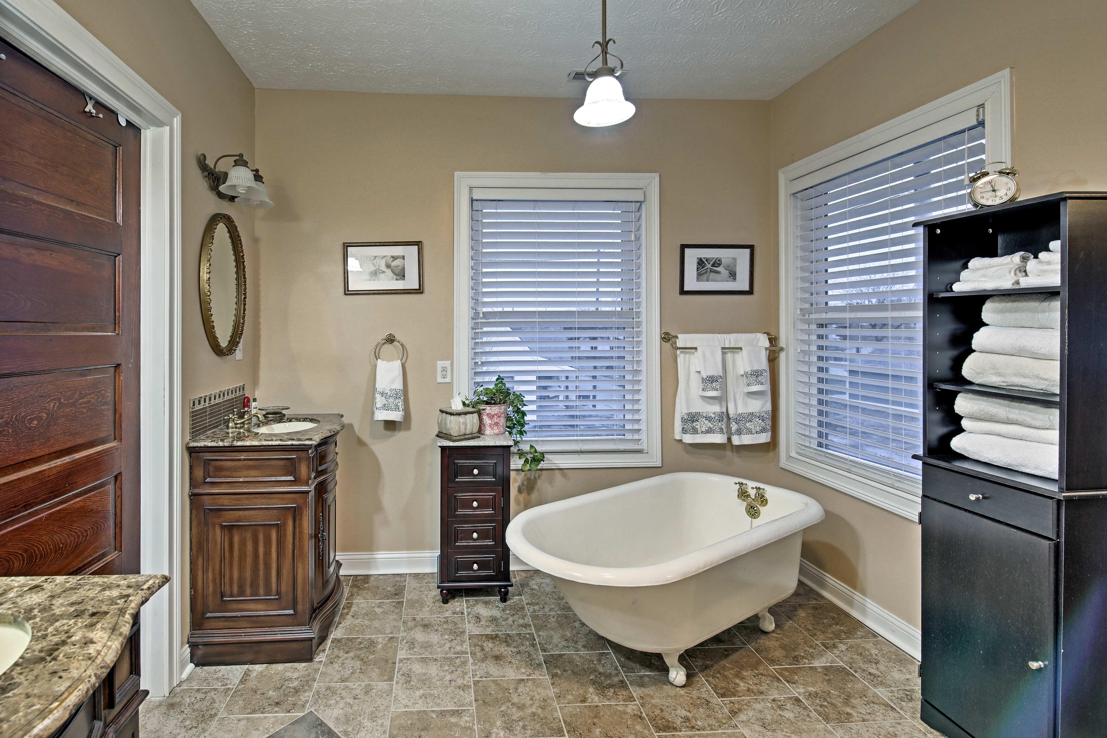 Enjoy a soothing soak in the bathtub.