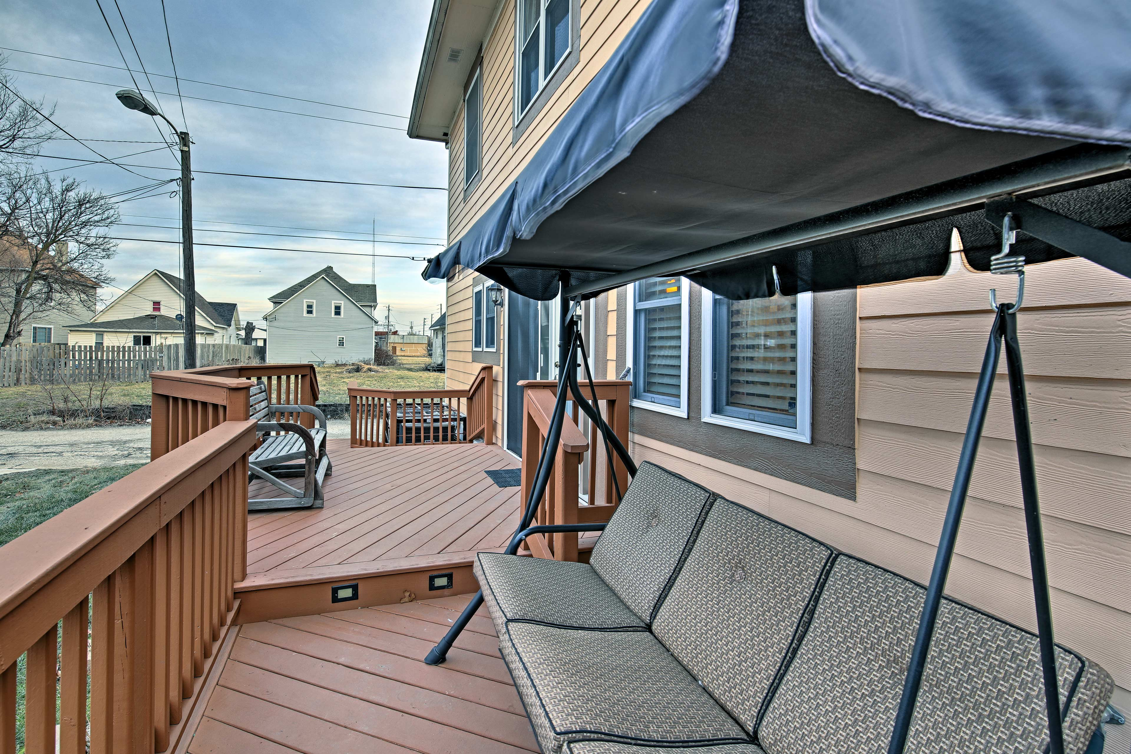 Unwind with a glass of wine on the back deck.