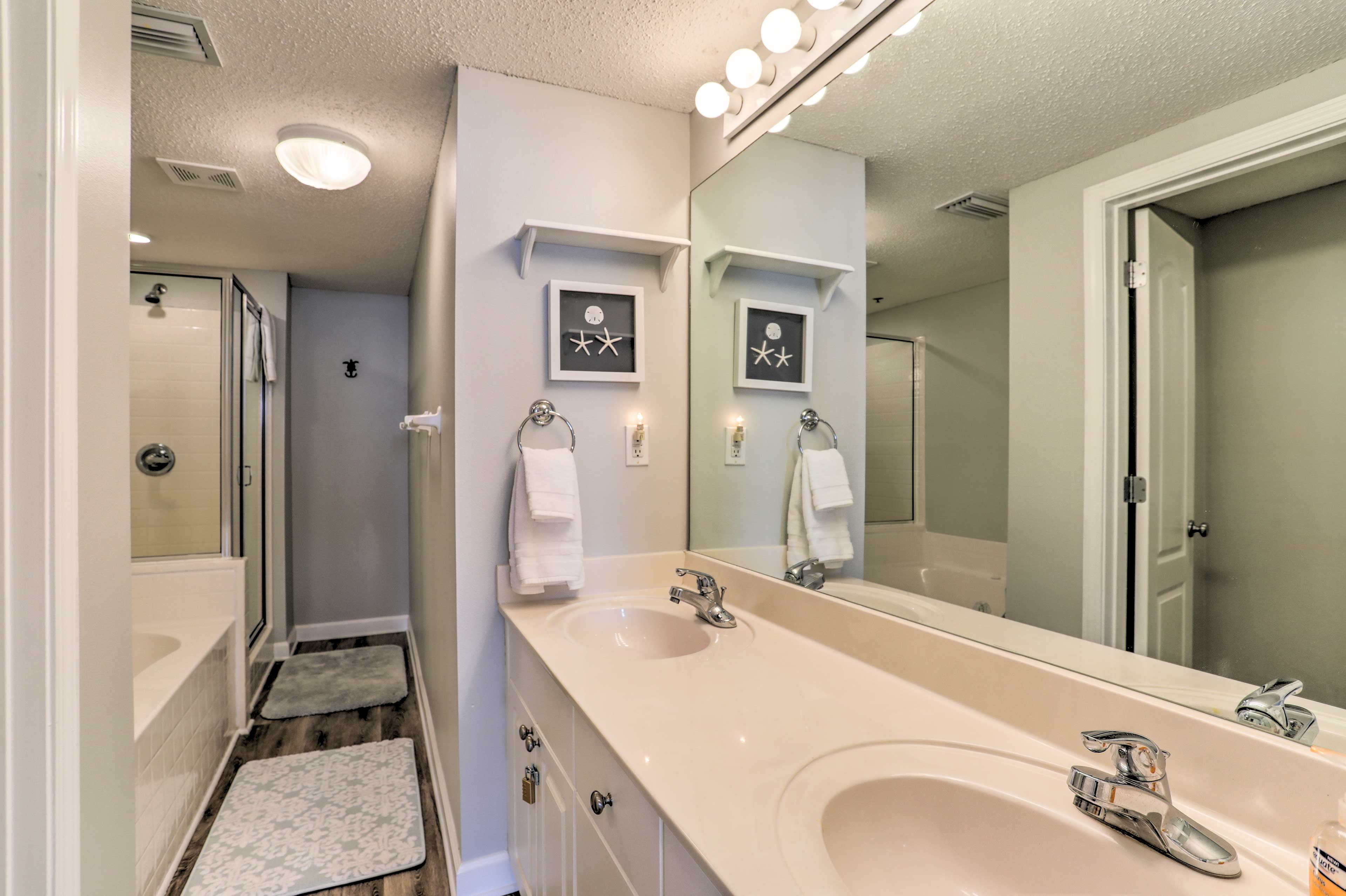 The master bedroom includes the added luxury of an en-suite bathroom.