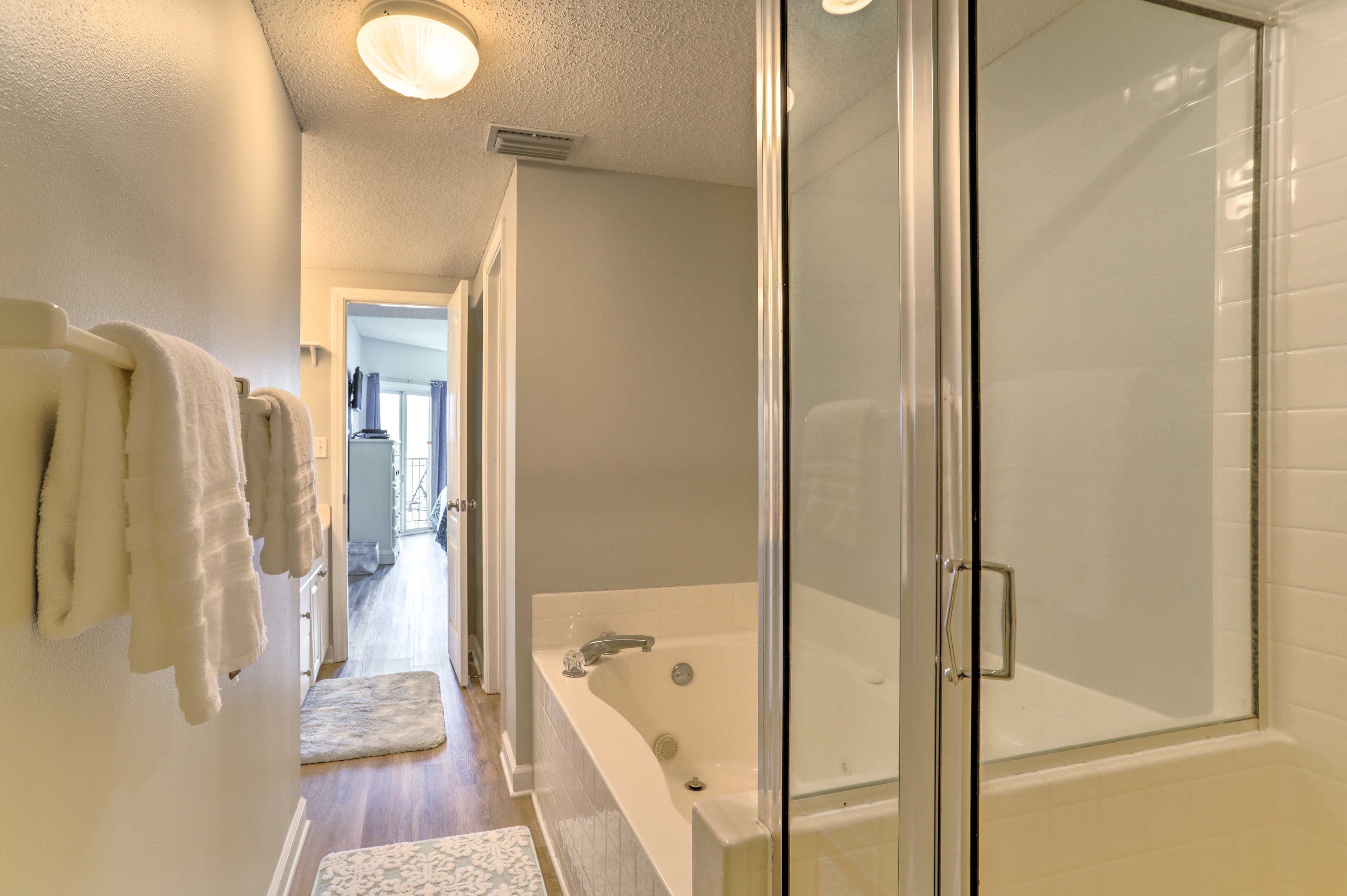 Enjoy a relaxing soak in the tub featured in the en-suite.