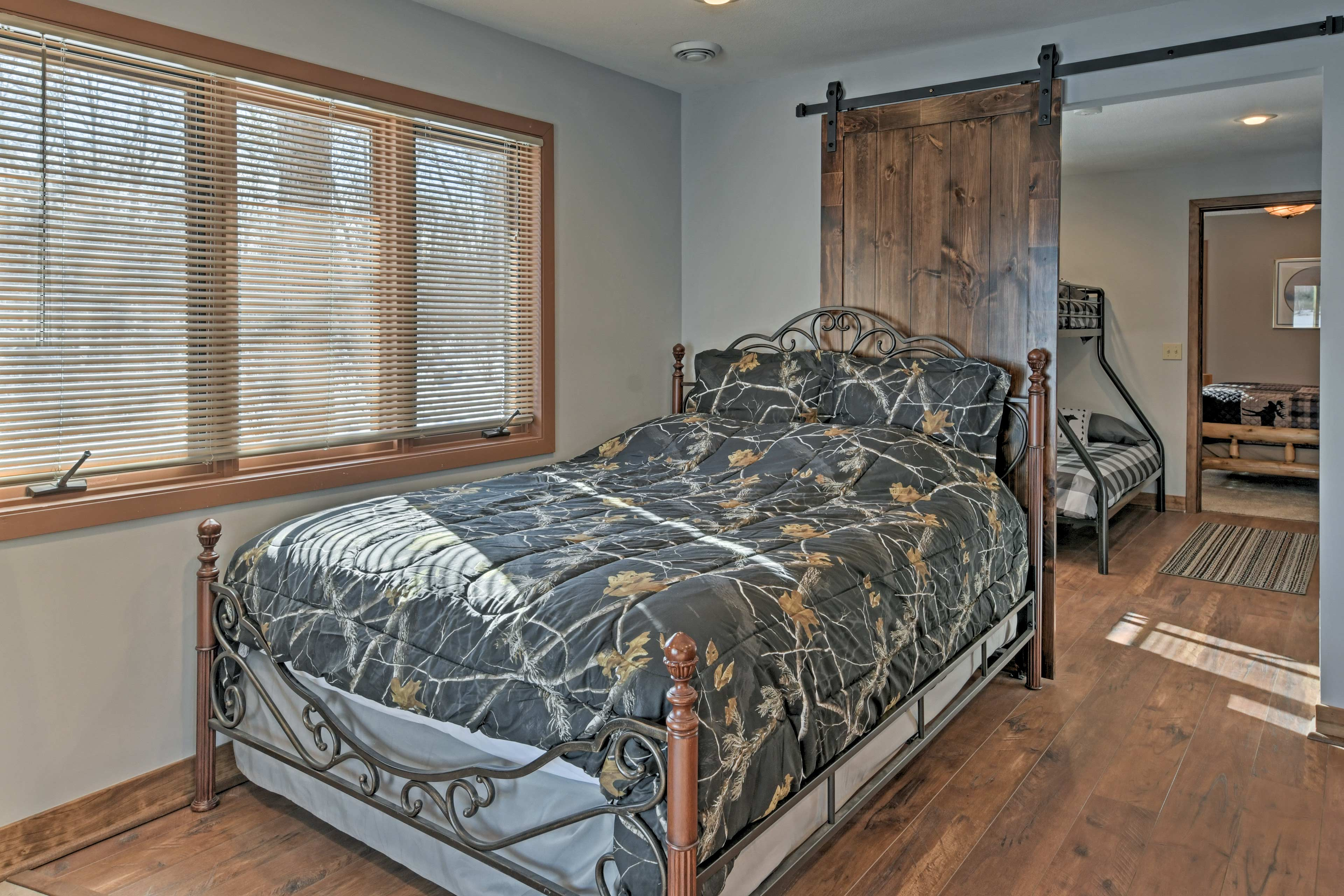 A queen bed can be found right off the basement.