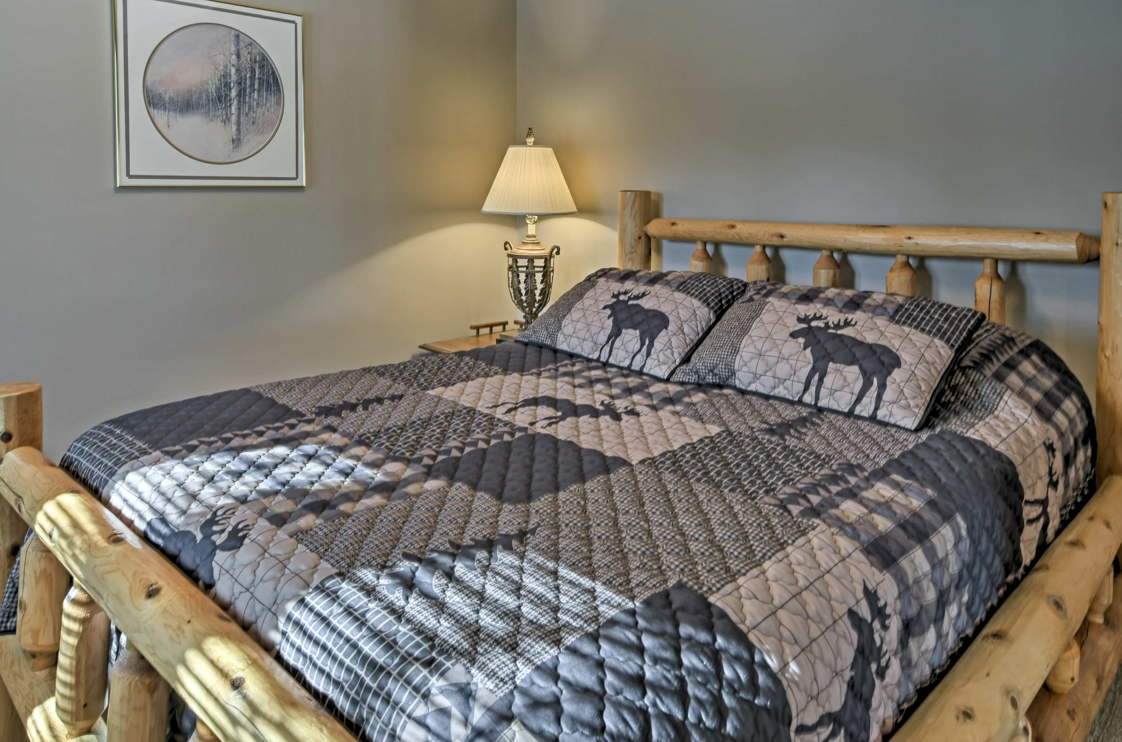 Find a cozy bedroom, complete with a queen bed, in the basement.
