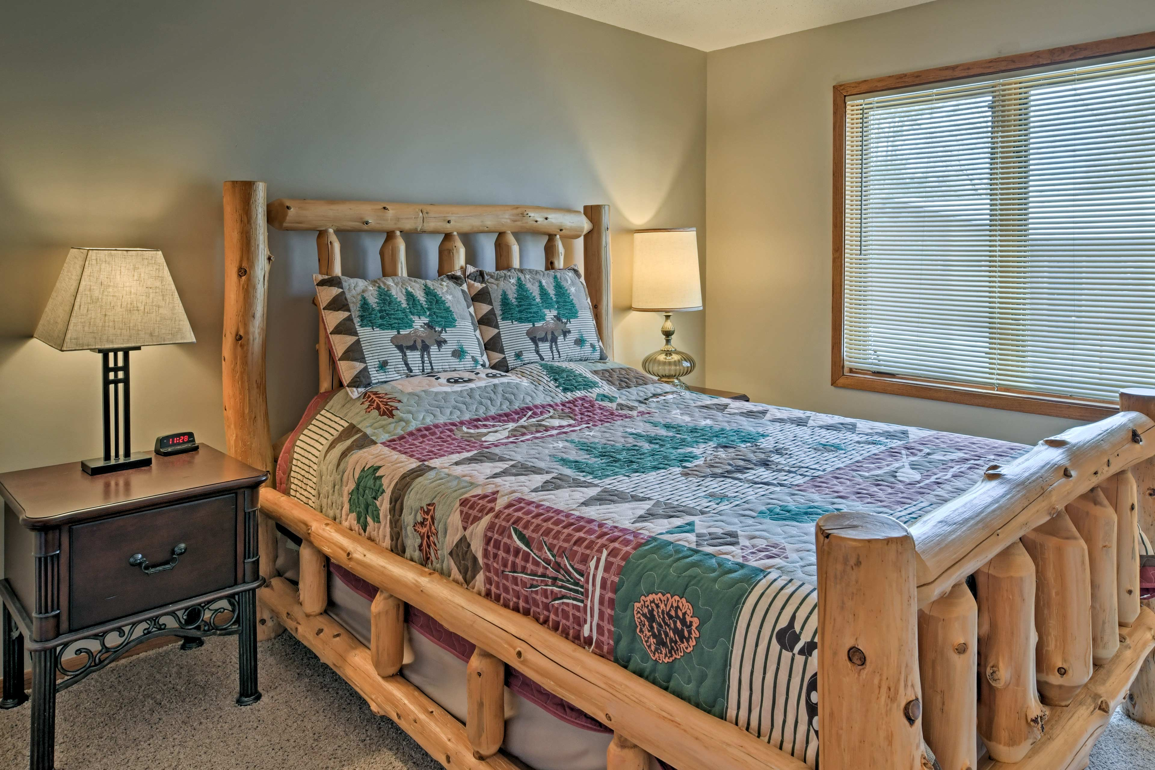 Sleep is sure to come easy on this lovely queen bed.