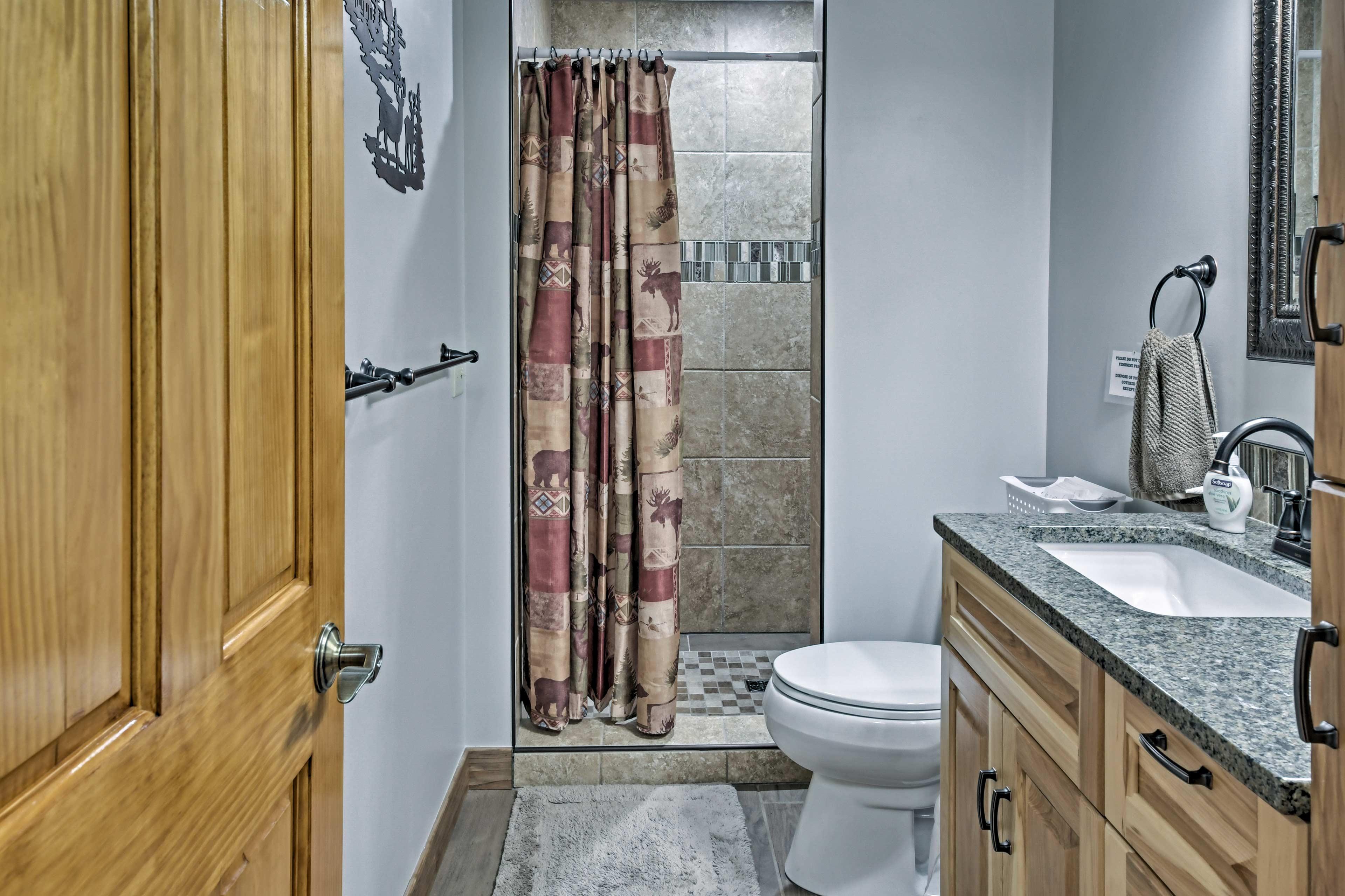 A walk-in shower highlights the bathroom.