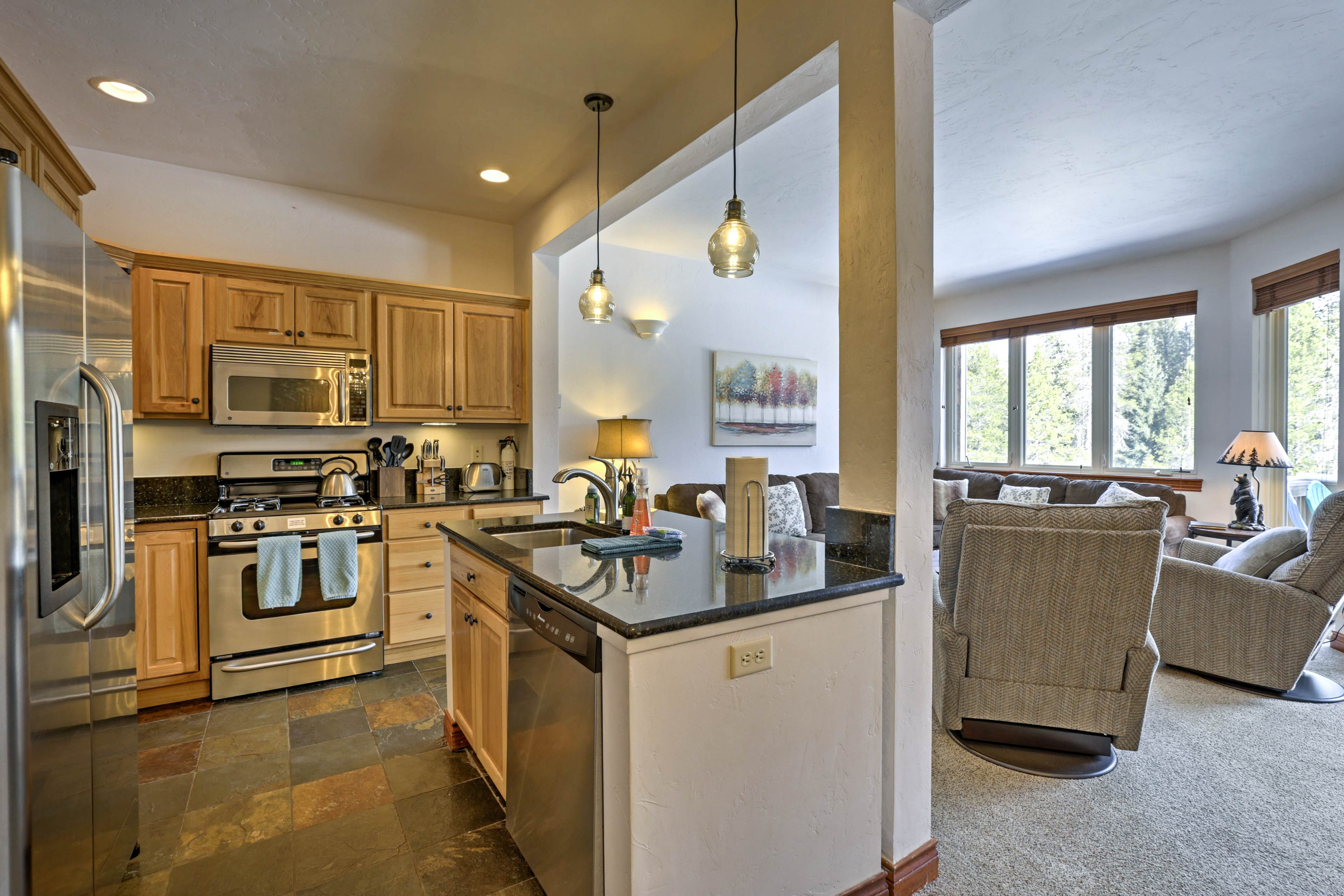 Serve appetizers at the breakfast bar and dinner around the wood dining table.