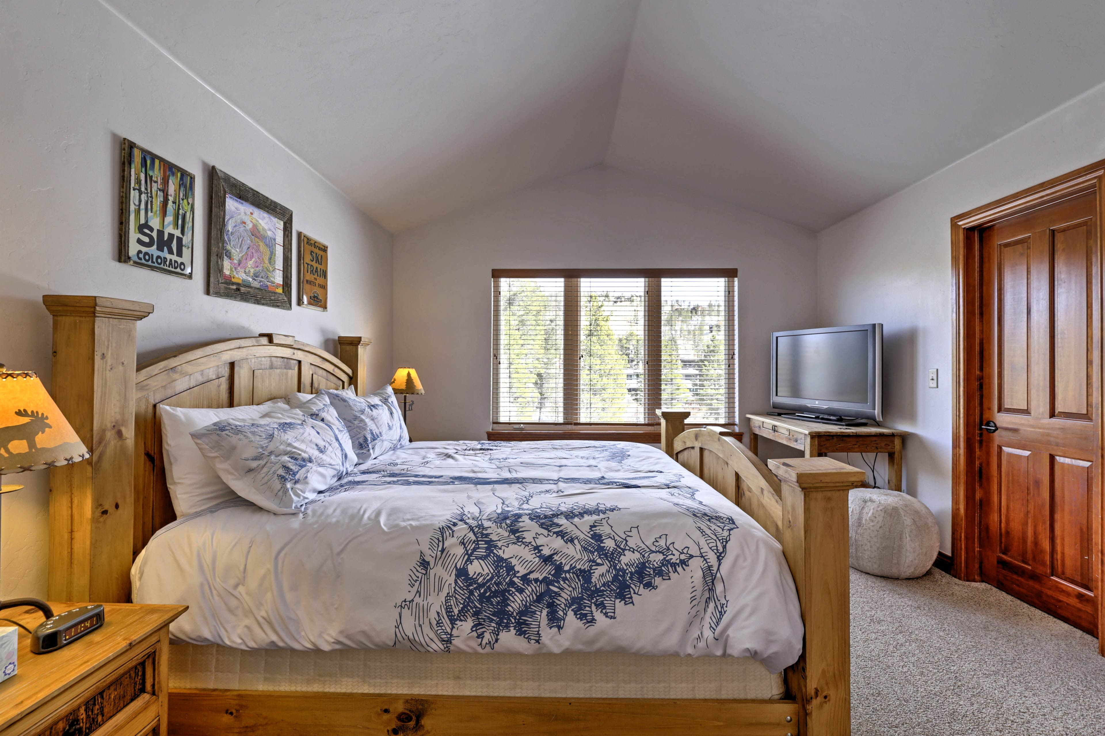 The master bedroom features a king bed, flat-screen TV and en-suite bathroom.