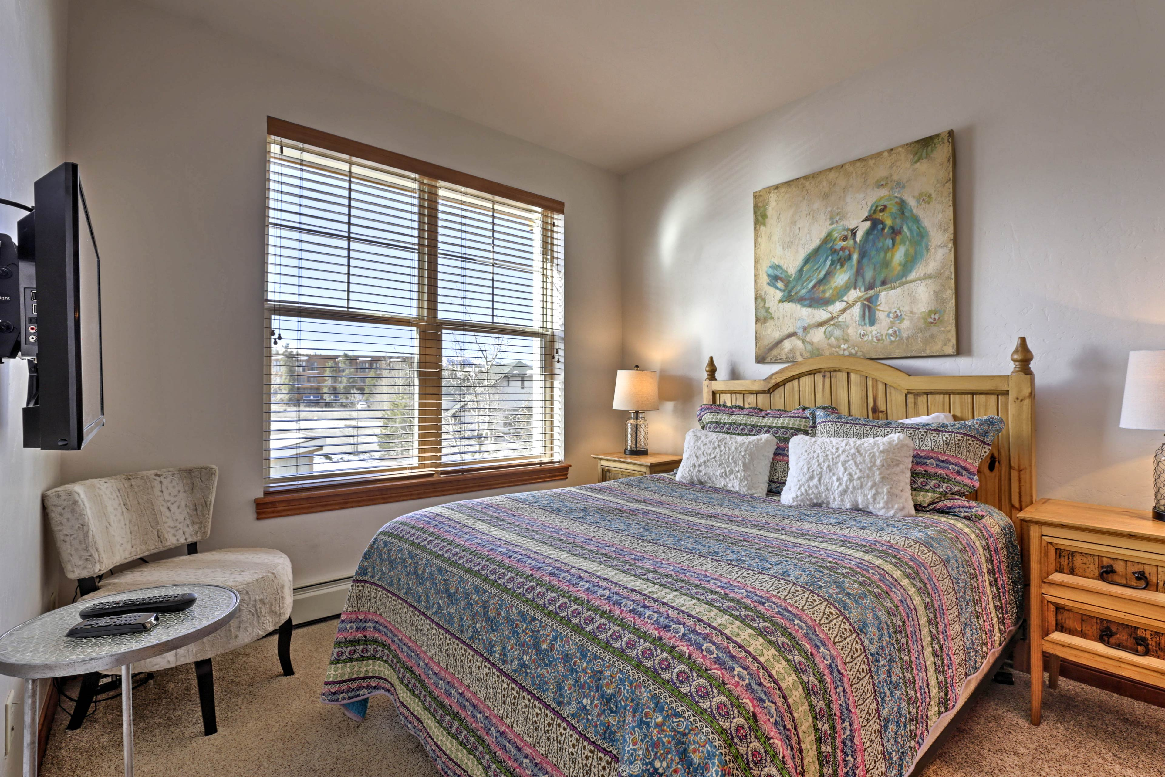 Two can share this bedroom offering a plush queen-sized bed.