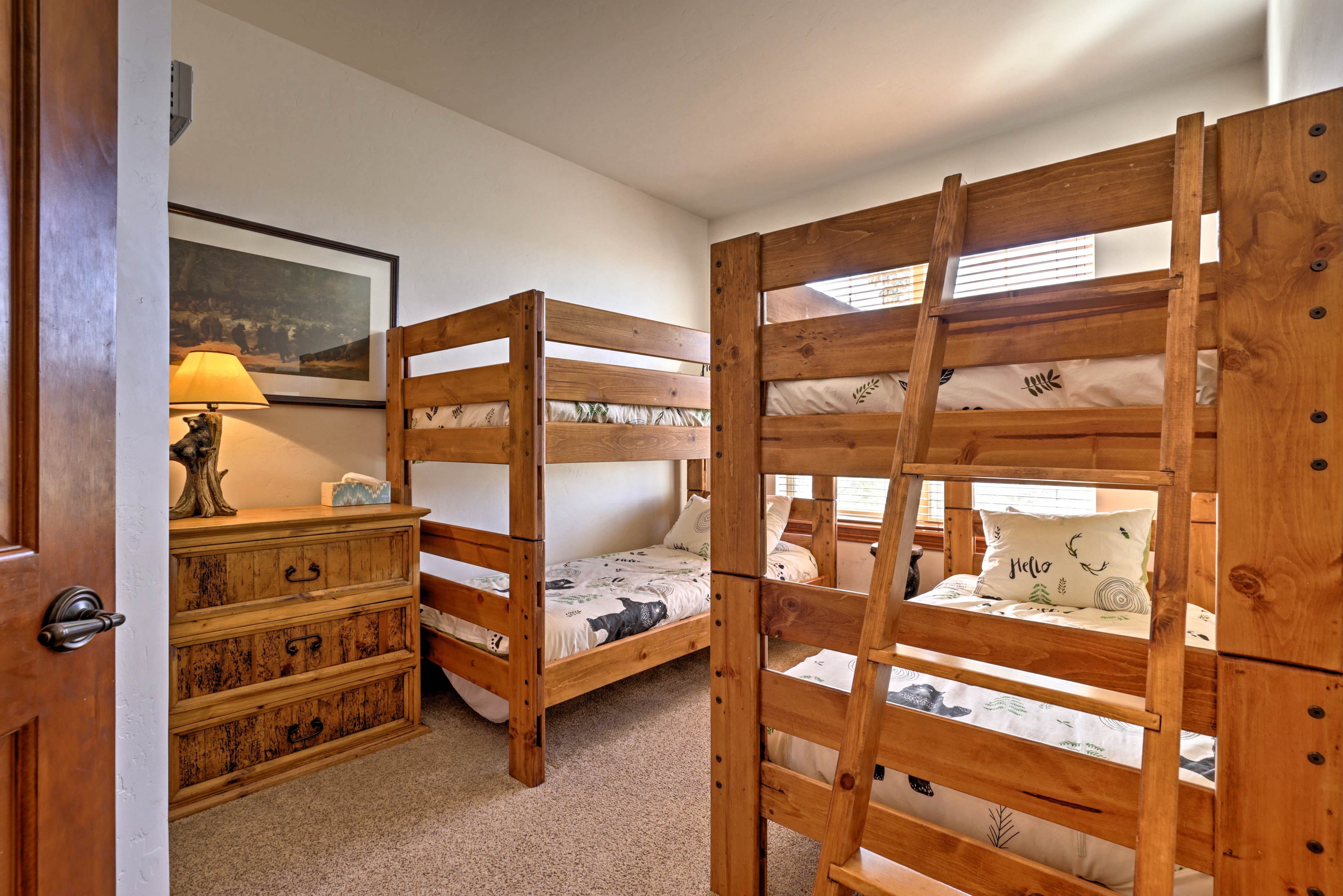 This bedroom offers 2 twin-over-twin bunk beds - perfect for the kiddos!