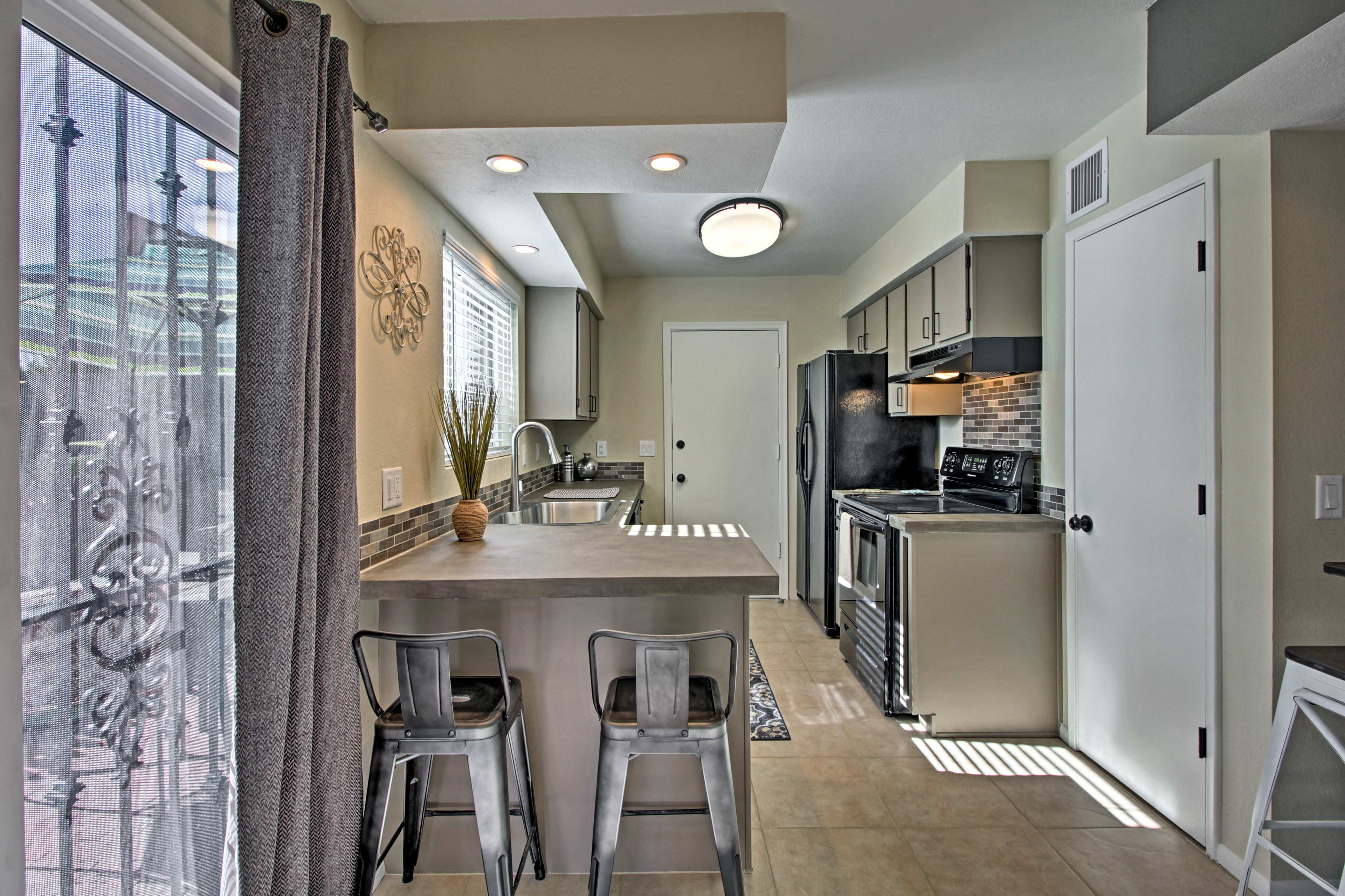 Treat loved ones to a homemade meal at the 2-person breakfast bar.
