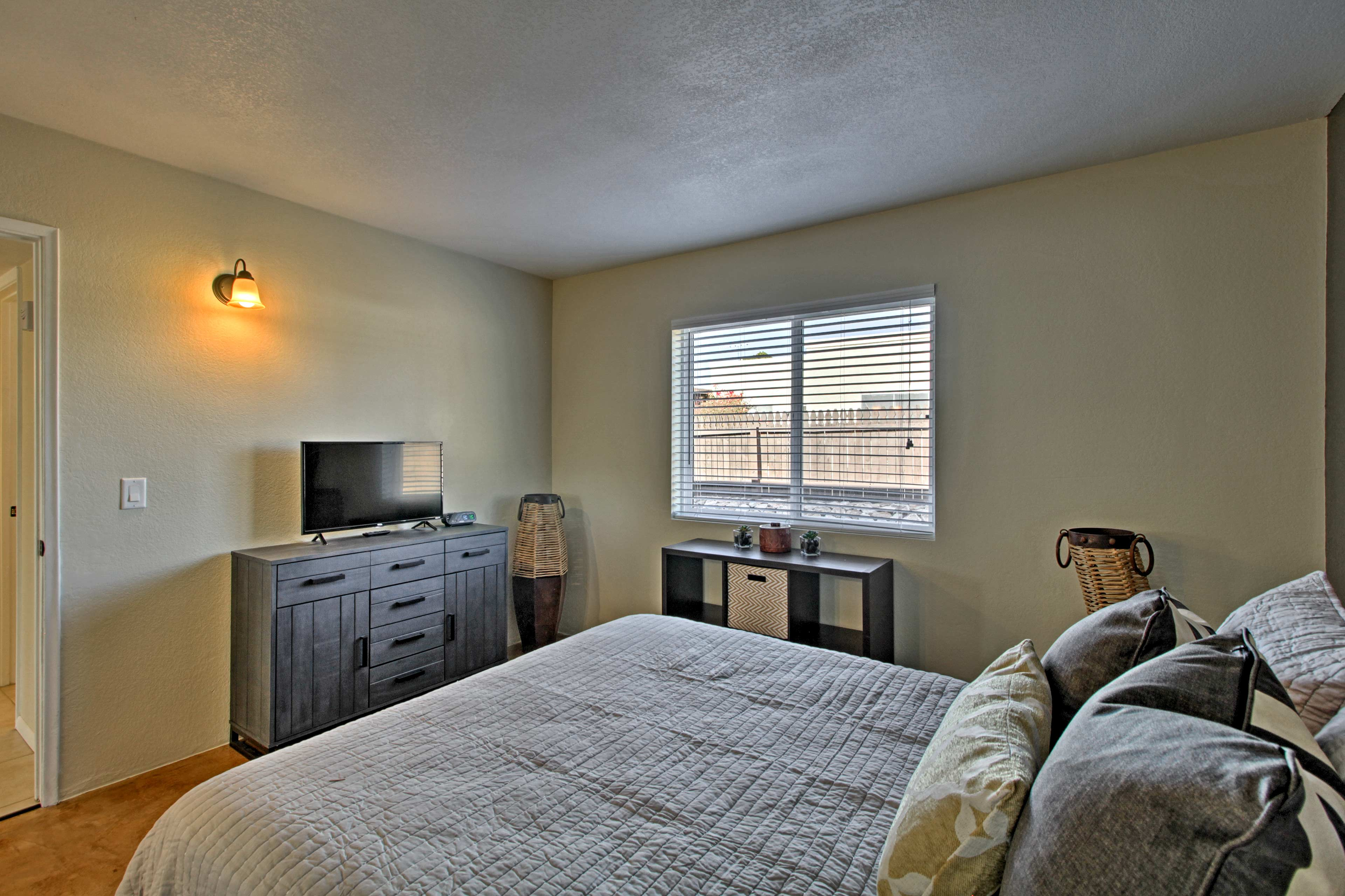Enjoy a bit of peace and privacy in front of the 32-inch flat-screen Smart TV.