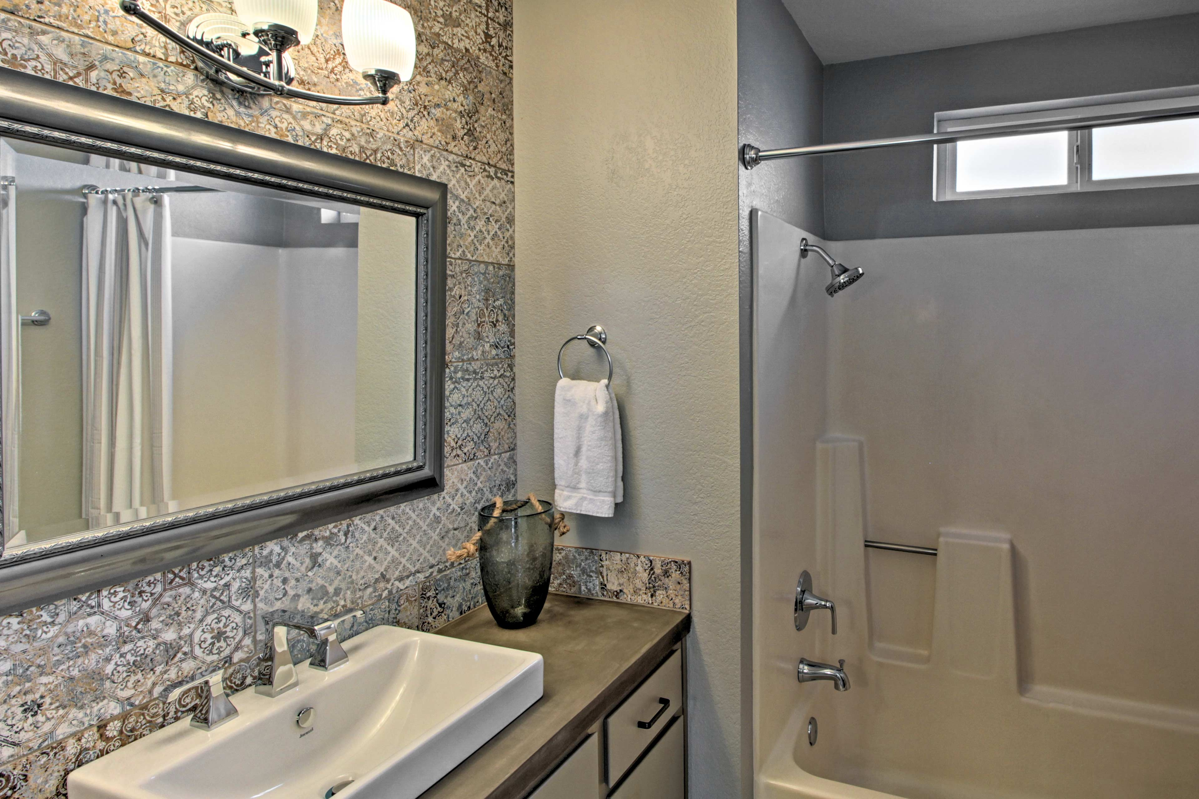 Wash up in the full bath, equipped with a shower/tub combo and single vanity.