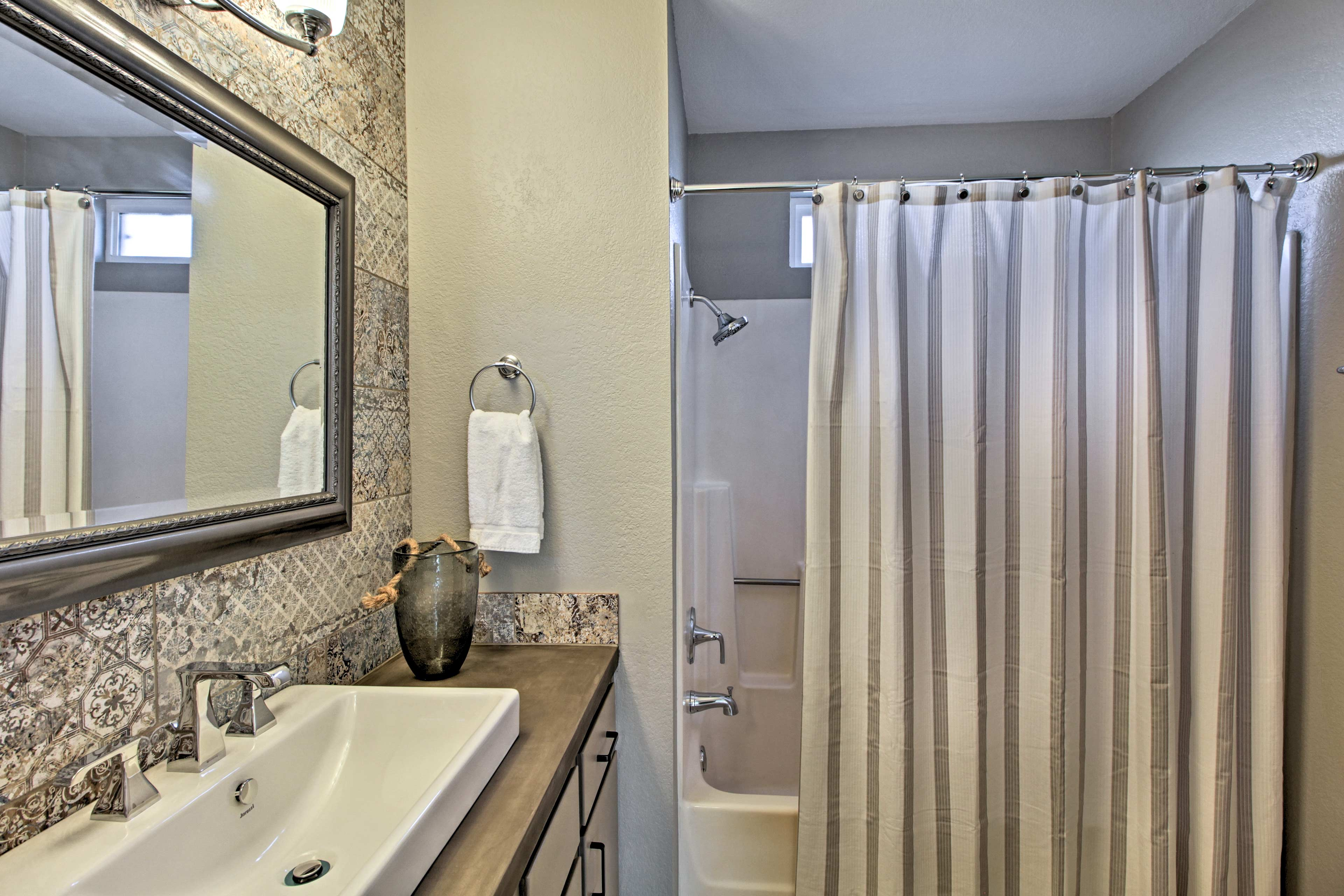 Utilize the shower/tub combo & single vanity found in the second full bathroom.