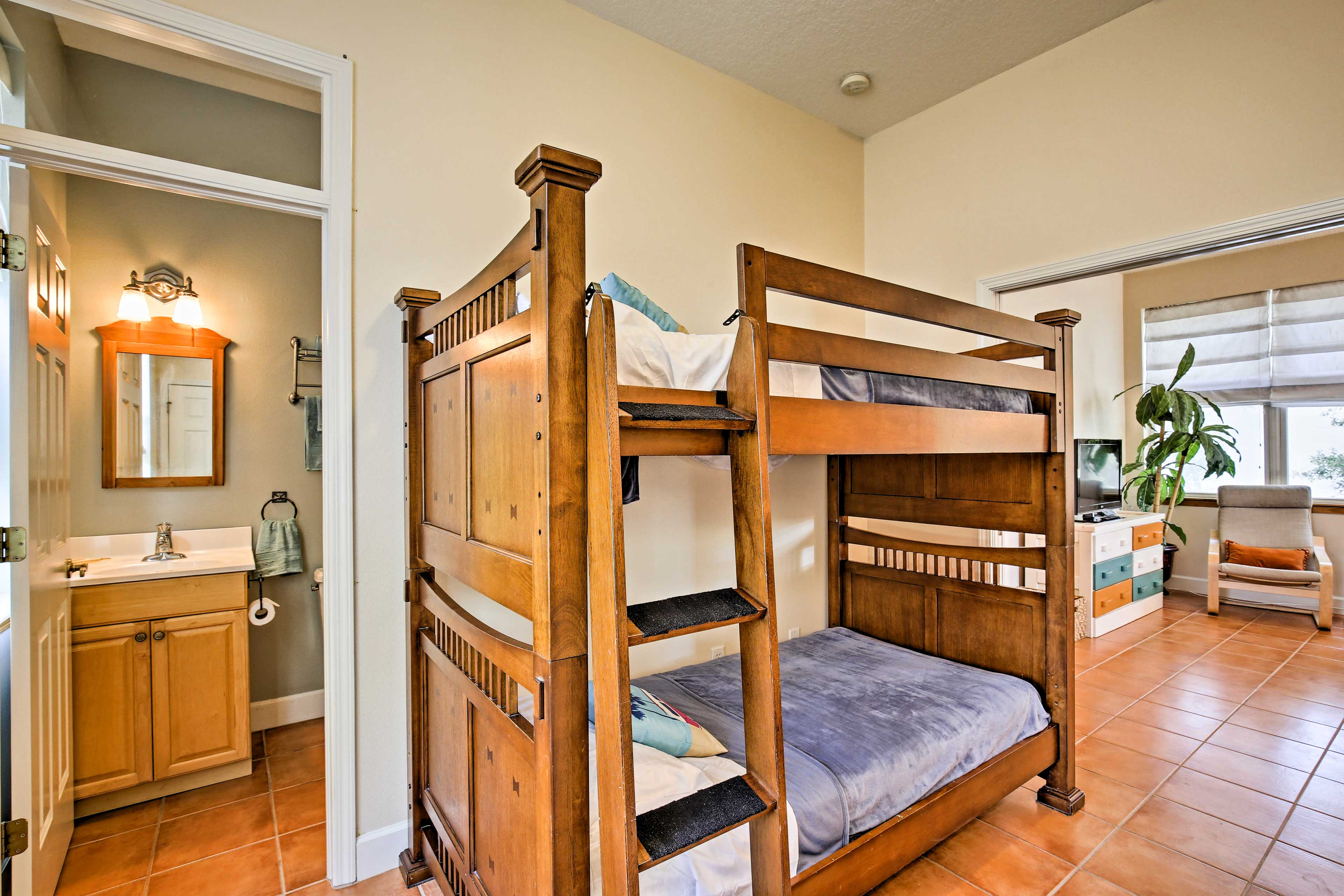 Your little ones will love this twin-over-twin bunk bed.