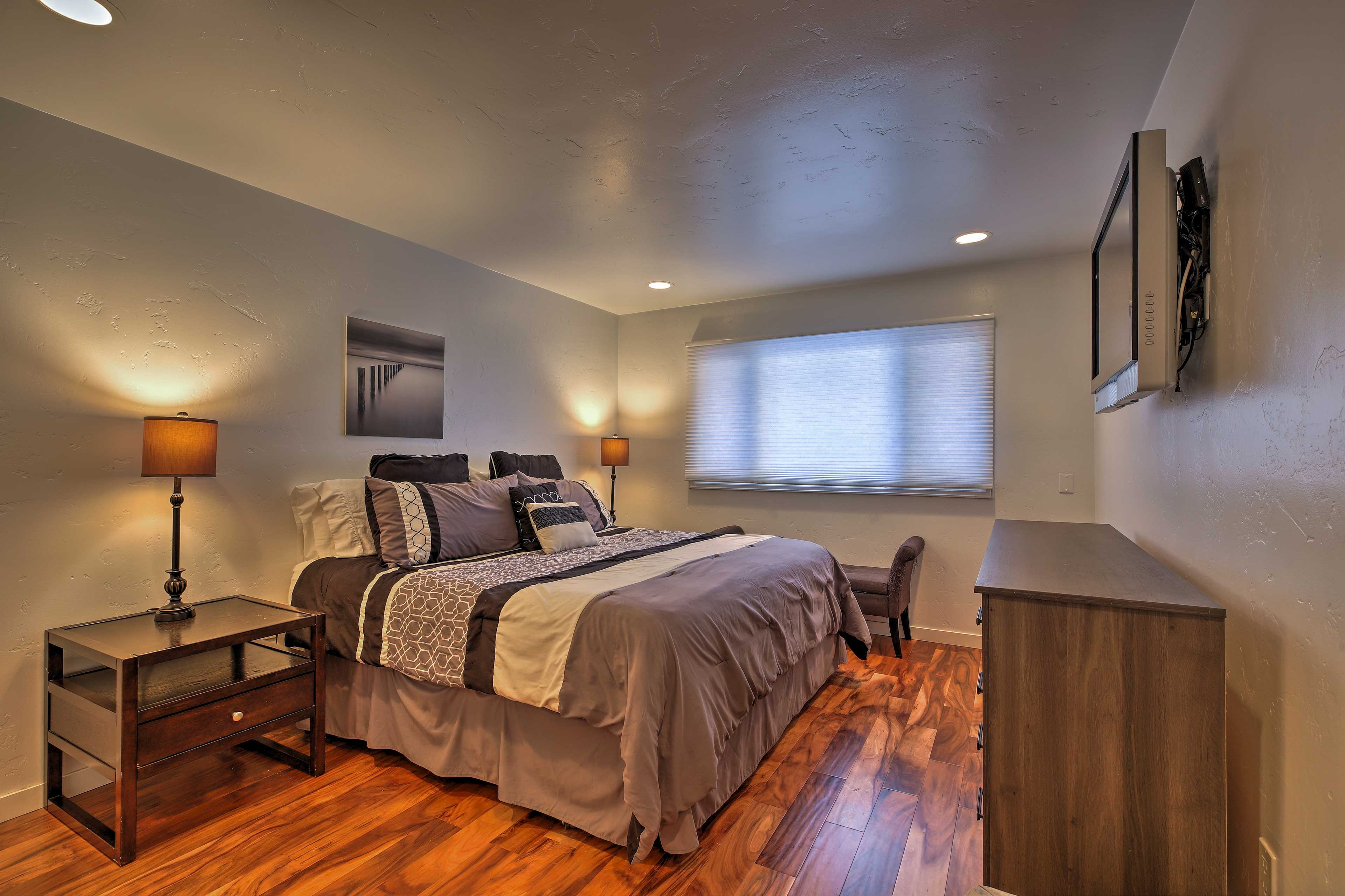 Enjoy peaceful slumbers on the king bed in the master bedroom.