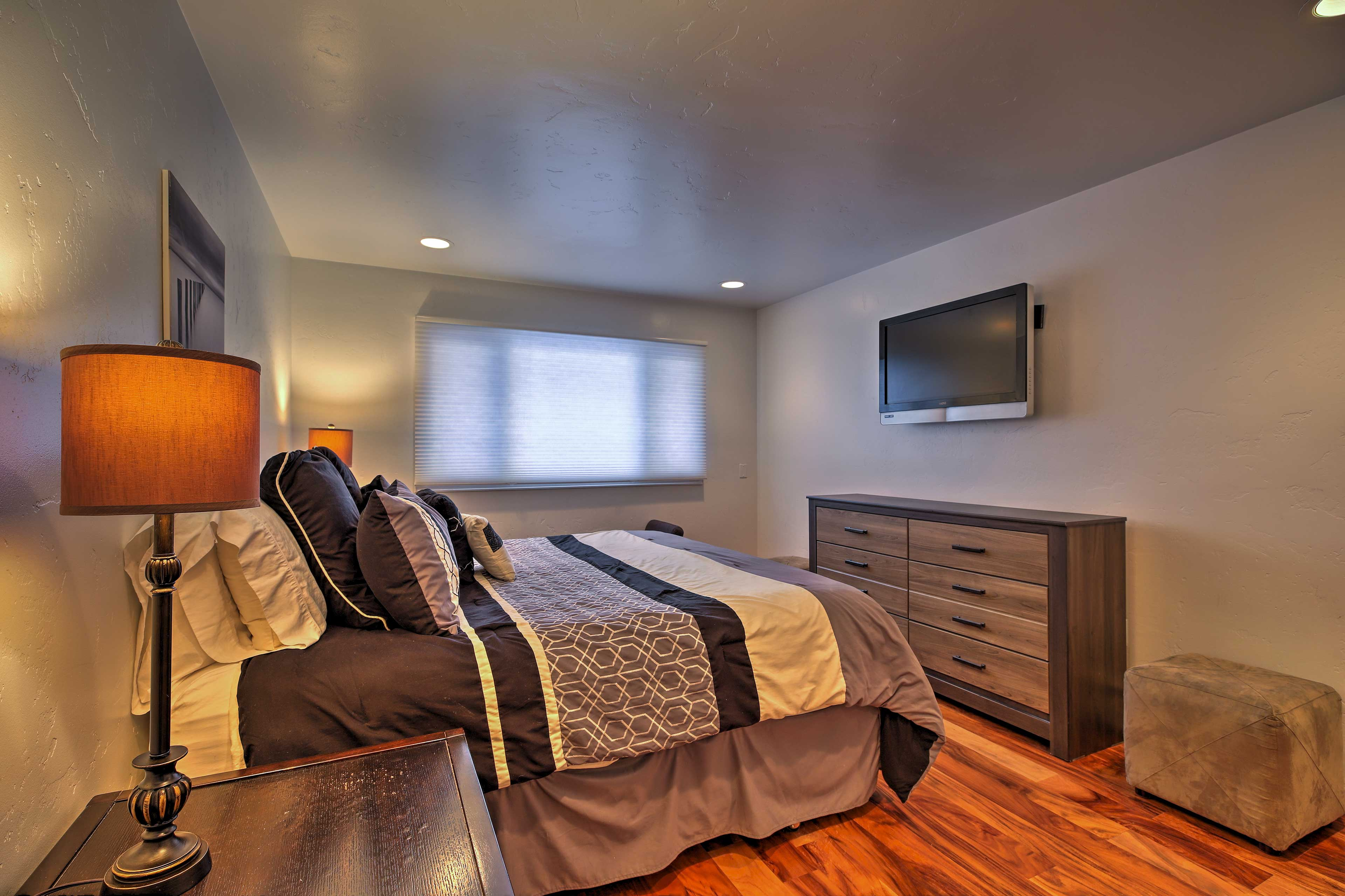 The master bedroom includes the added luxury of a flat-screen cable Smart TV.