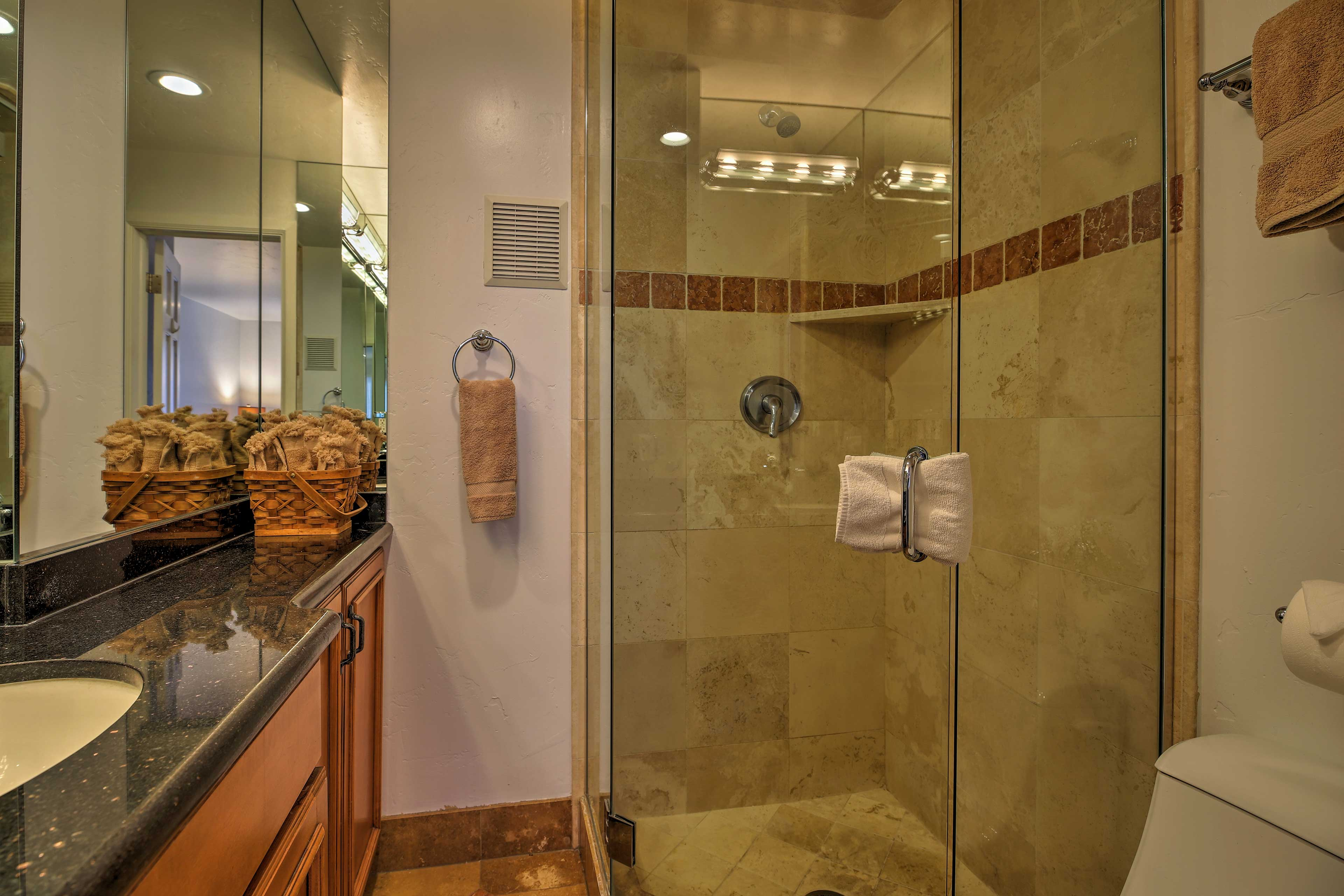 Wash up in the walk-in shower and single vanity.
