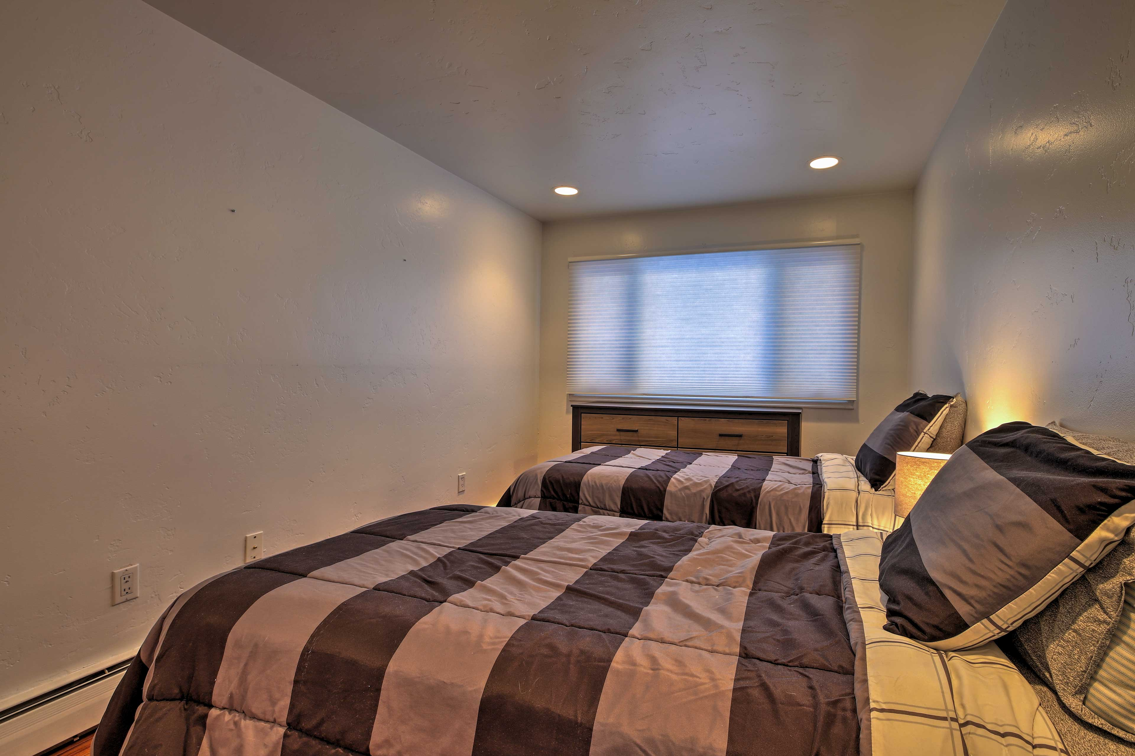 The second bedroom is equipped with 2 twin-sized beds.