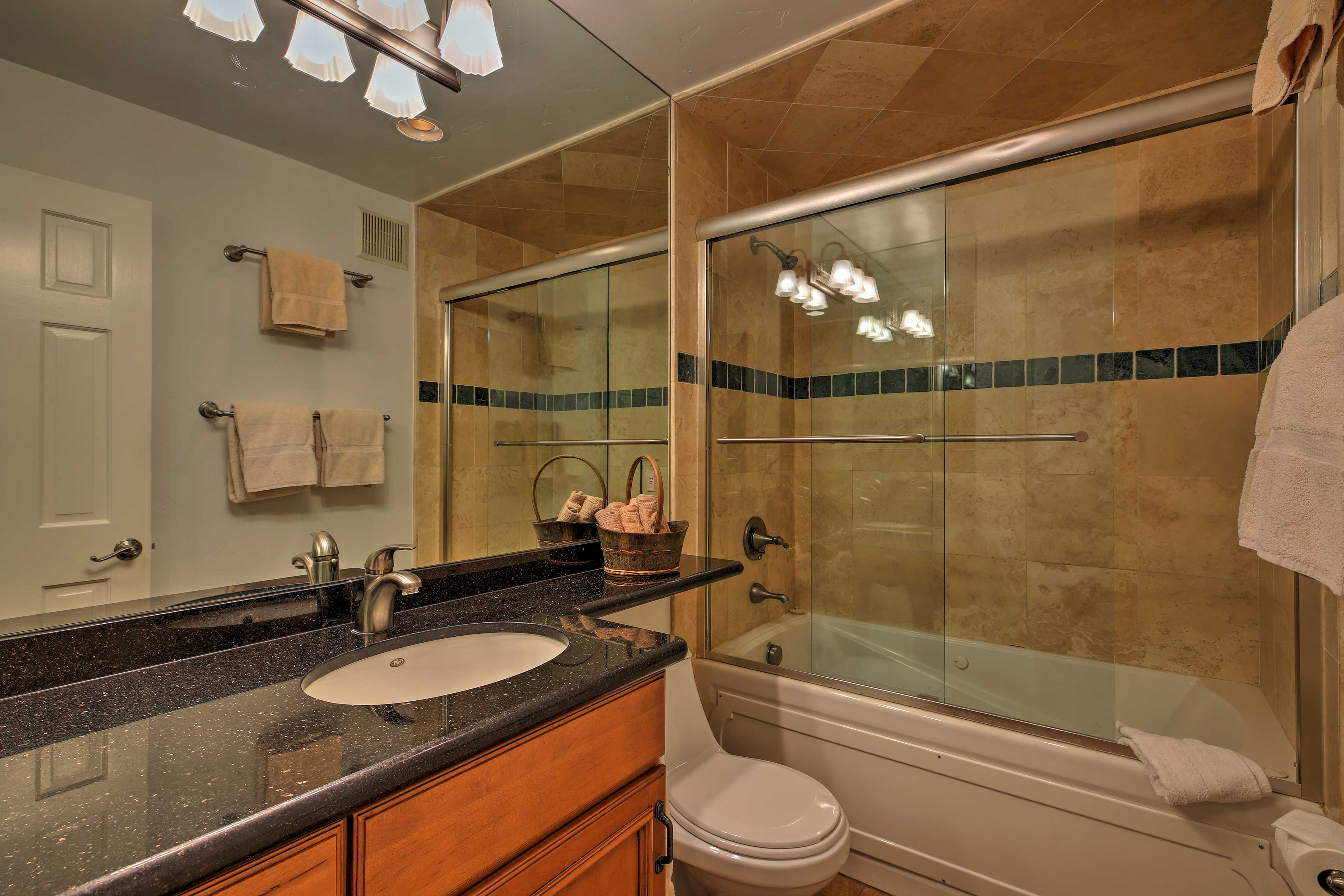 Utilize the single vanity and shower/tub combo featured in the second bathroom.