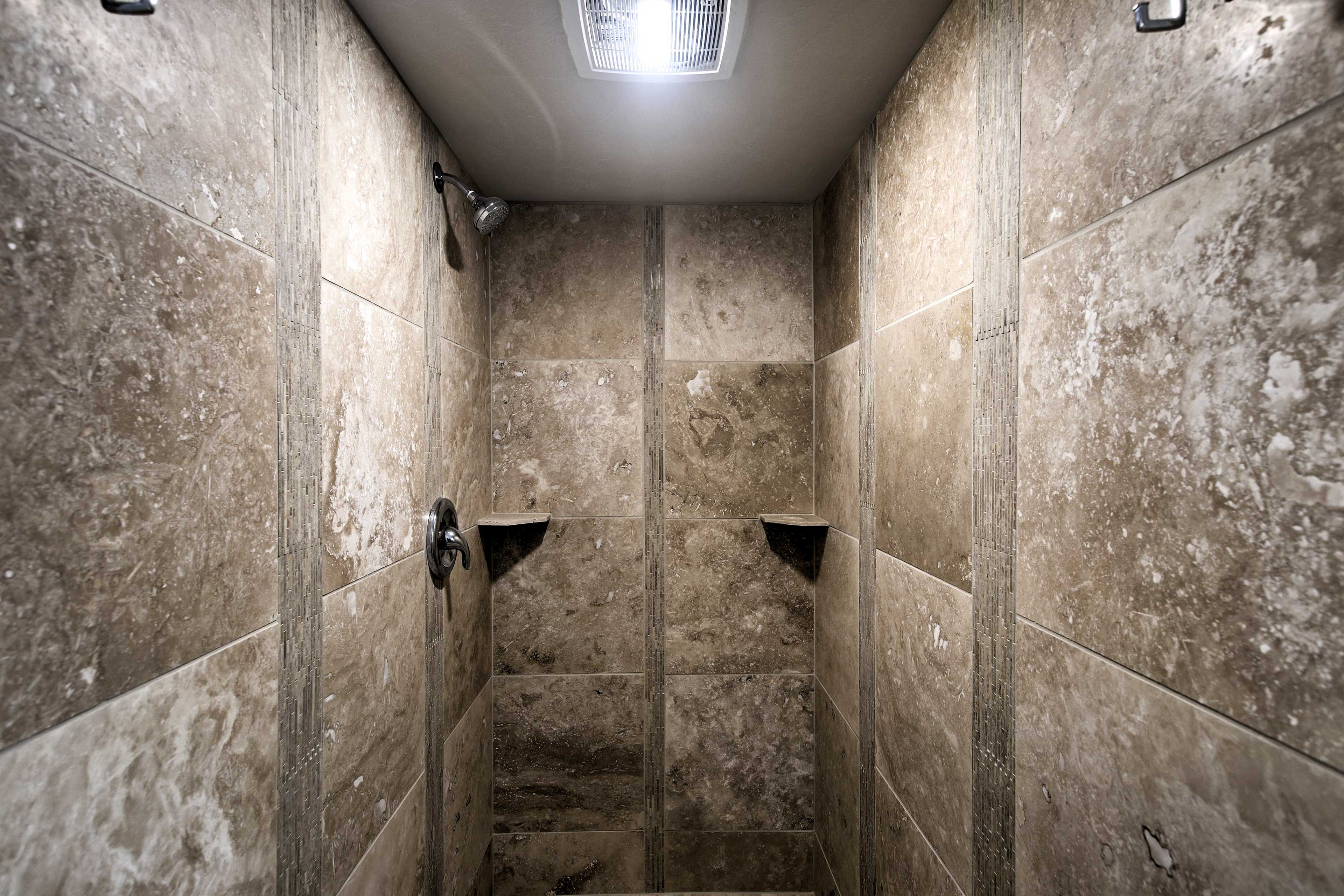 Wash away the day's efforts in this lavish walk-in shower.
