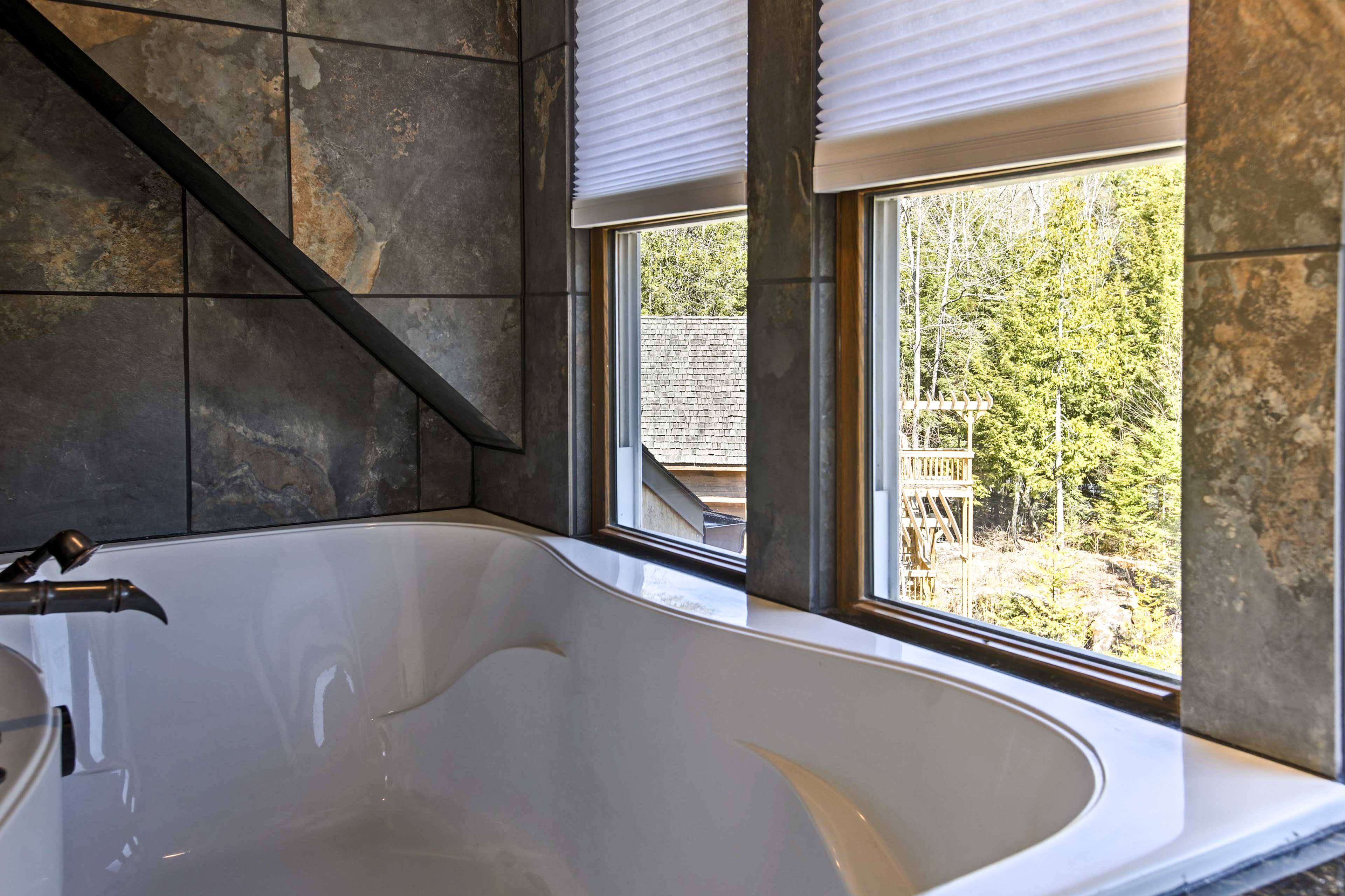 Treat yourself to a long soak in the private garden tub with picturesque views.