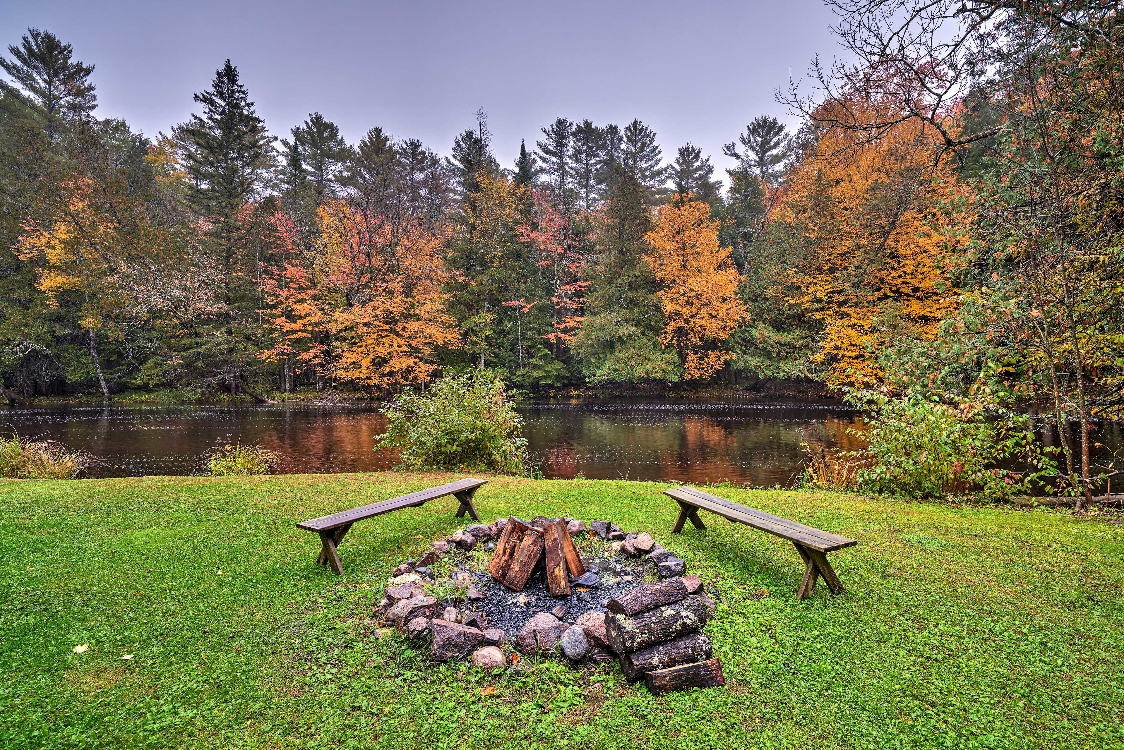 This Mountain cabin features a stellar location near the Oconto River!