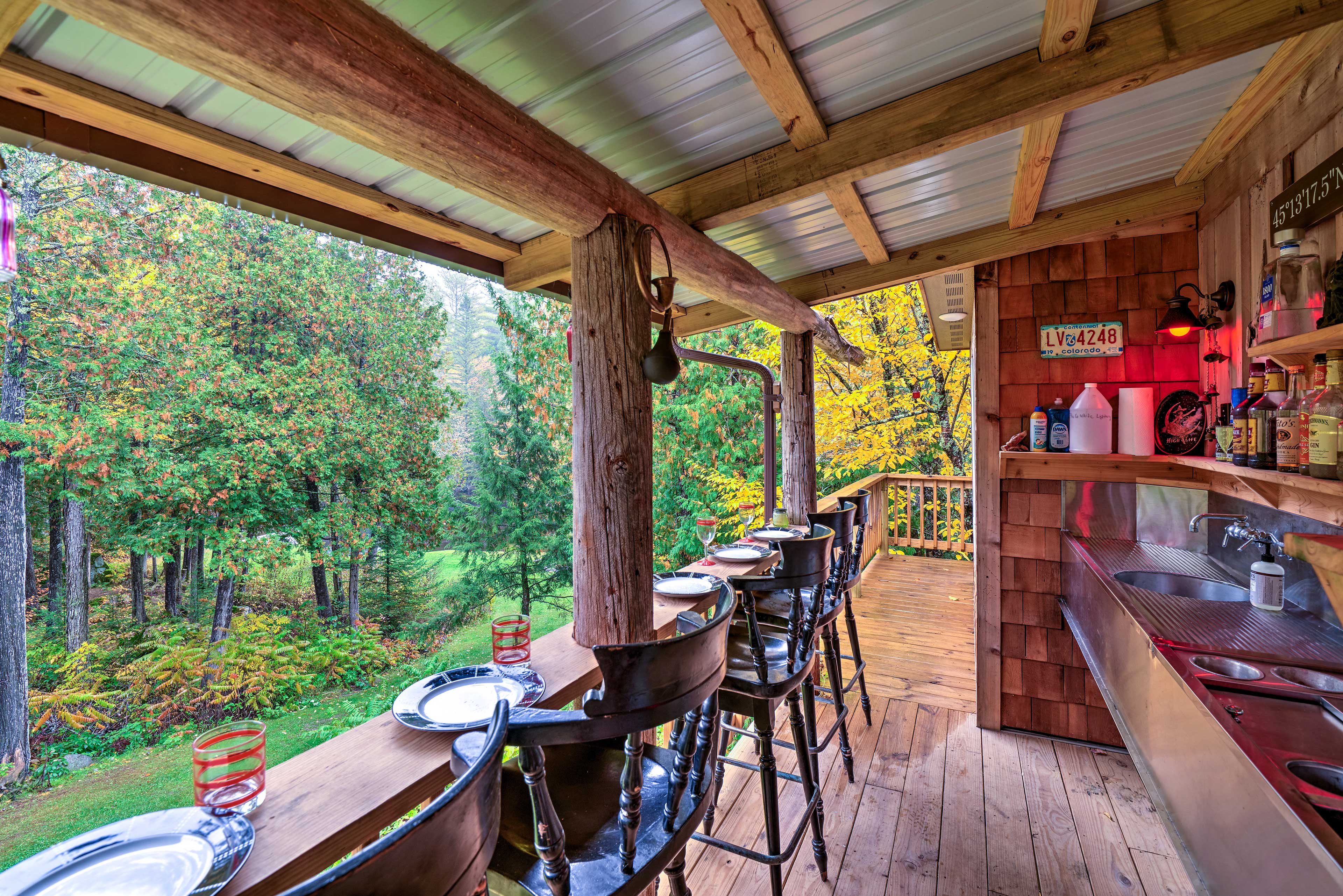 The 2-bedroom, 2-bathroom home sleeps 6 guests in a forest paradise.