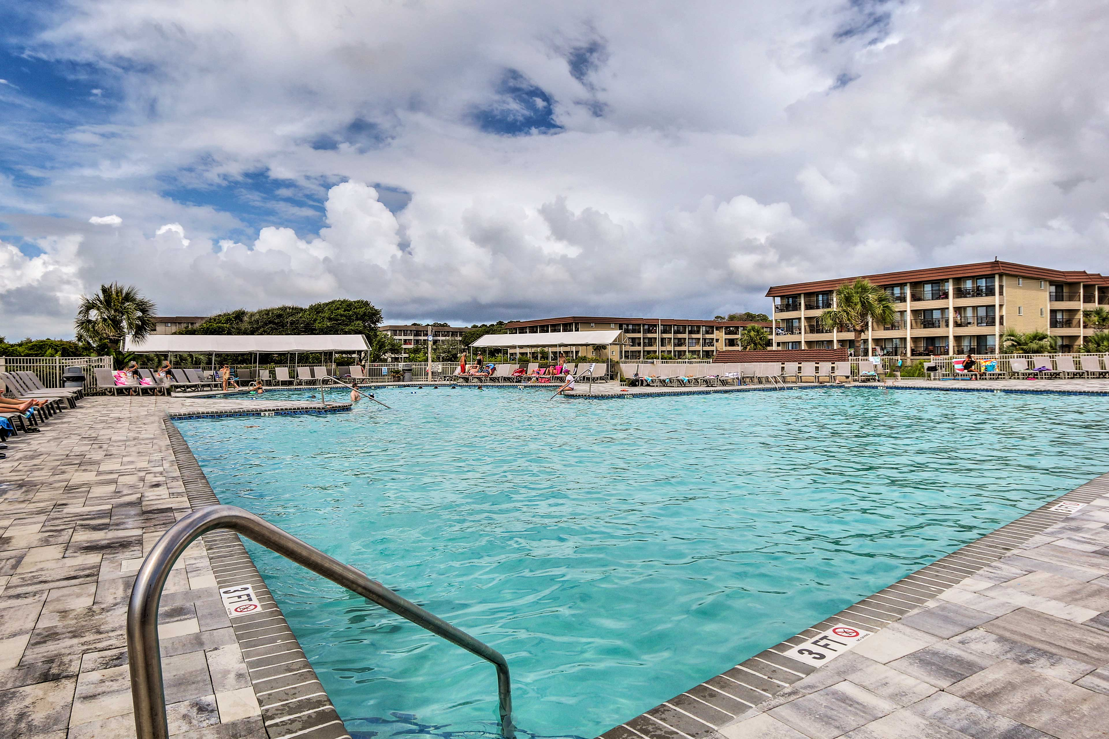 Take a dip in the expansive shared pool to cool off!