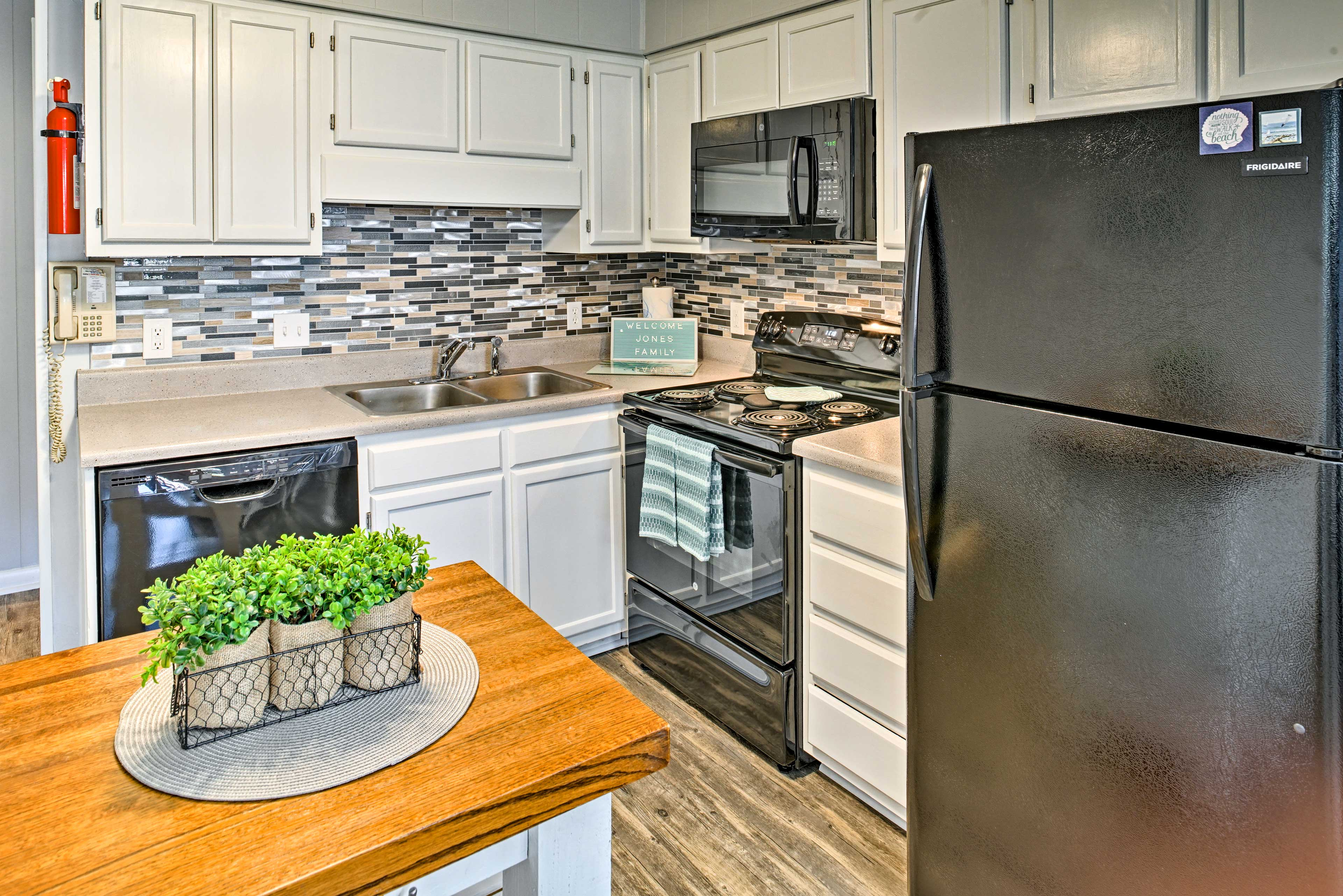 The kitchen is fully equipped with brand-new appliances and a kitchen island.