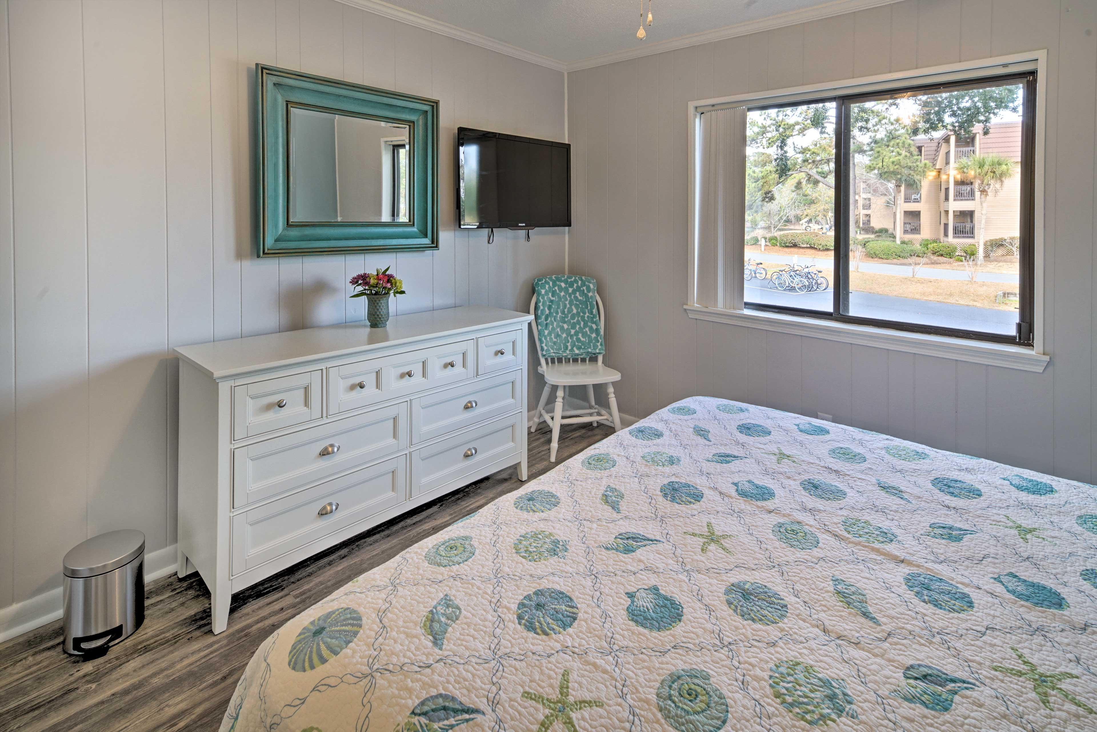 The master bedroom includes the a flat-screen TV and en-suite bathroom.