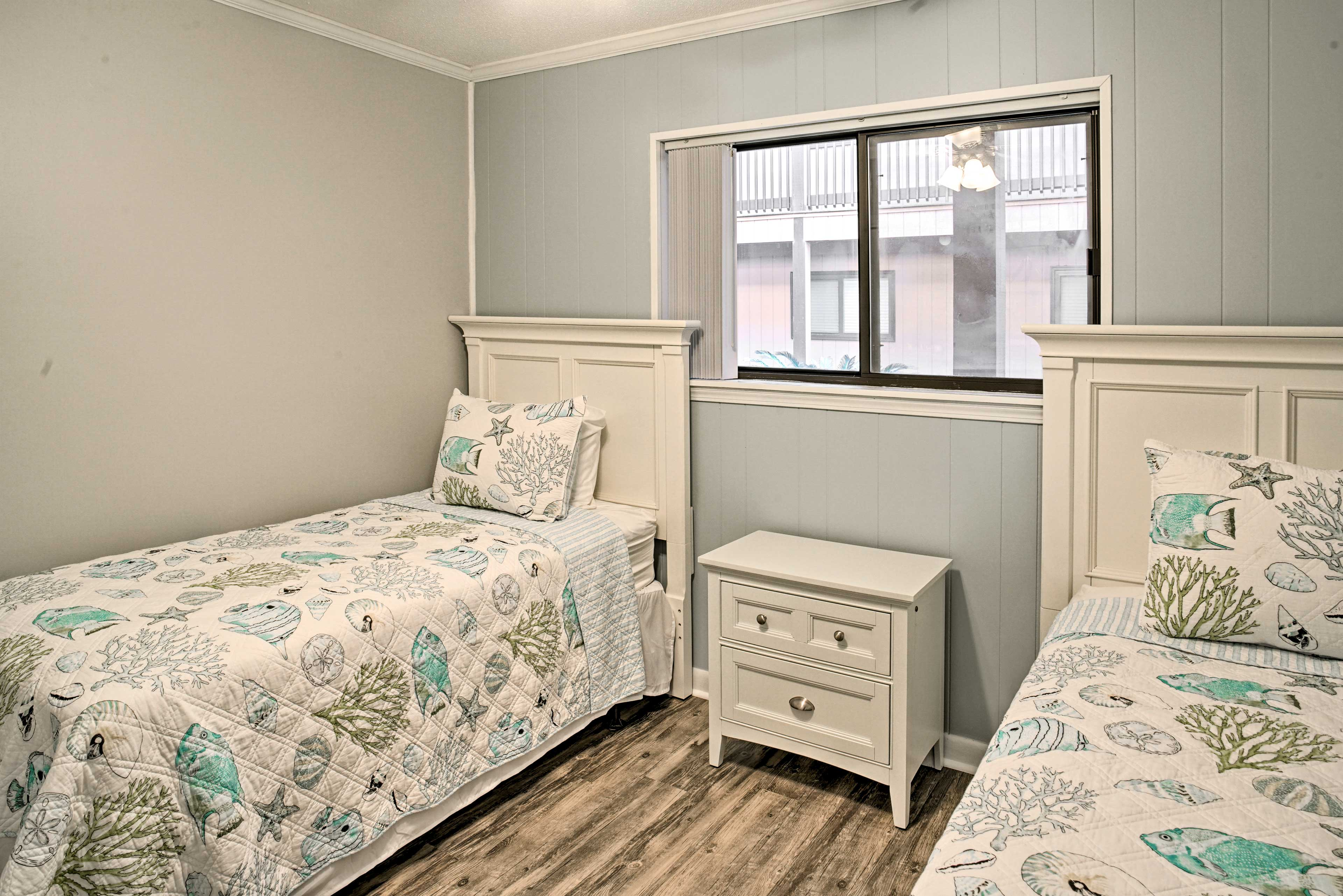The second bedroom now features 1 full bed and 1 twin bed.