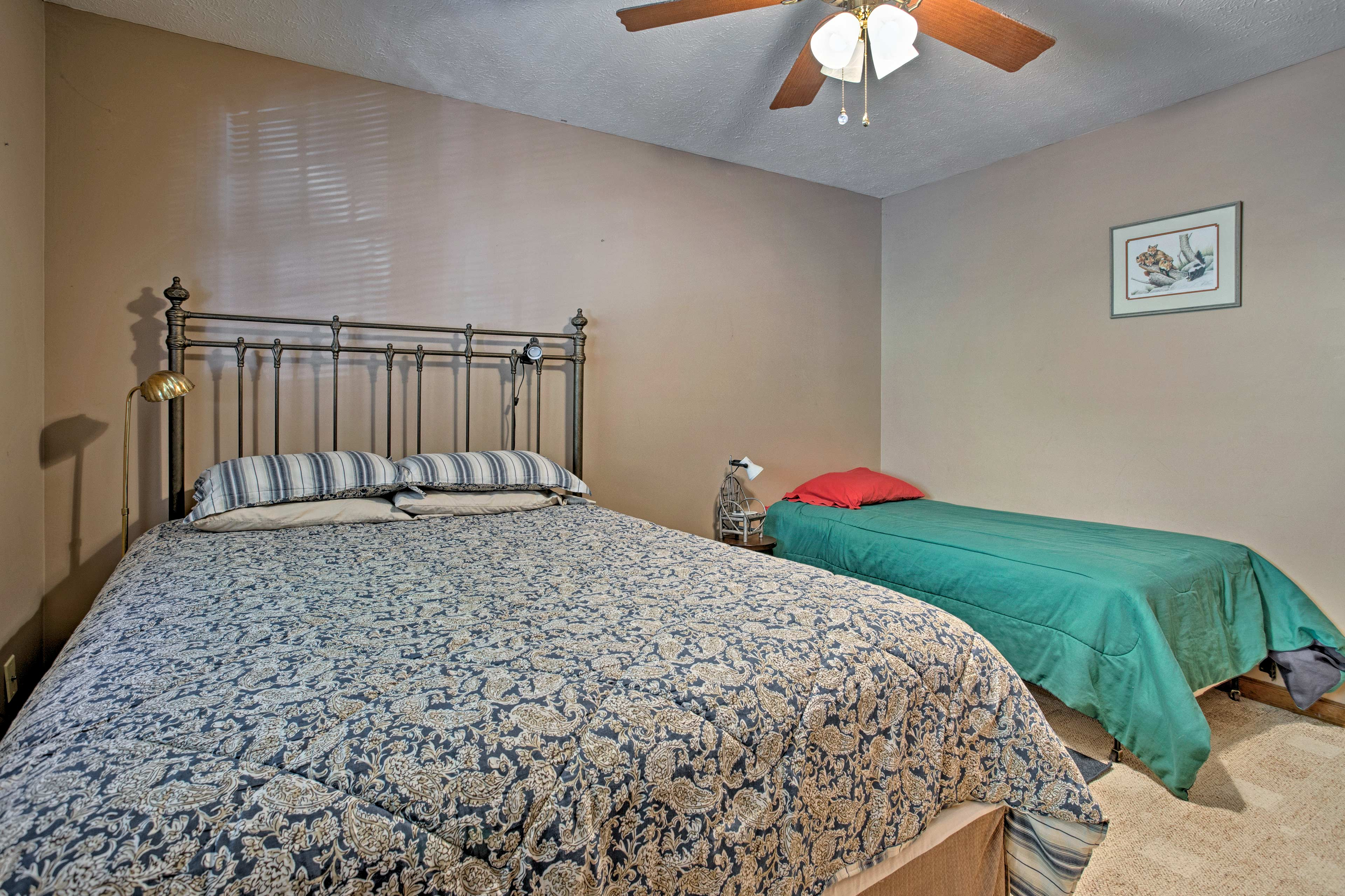 This room offers a queen bed and twin bed.