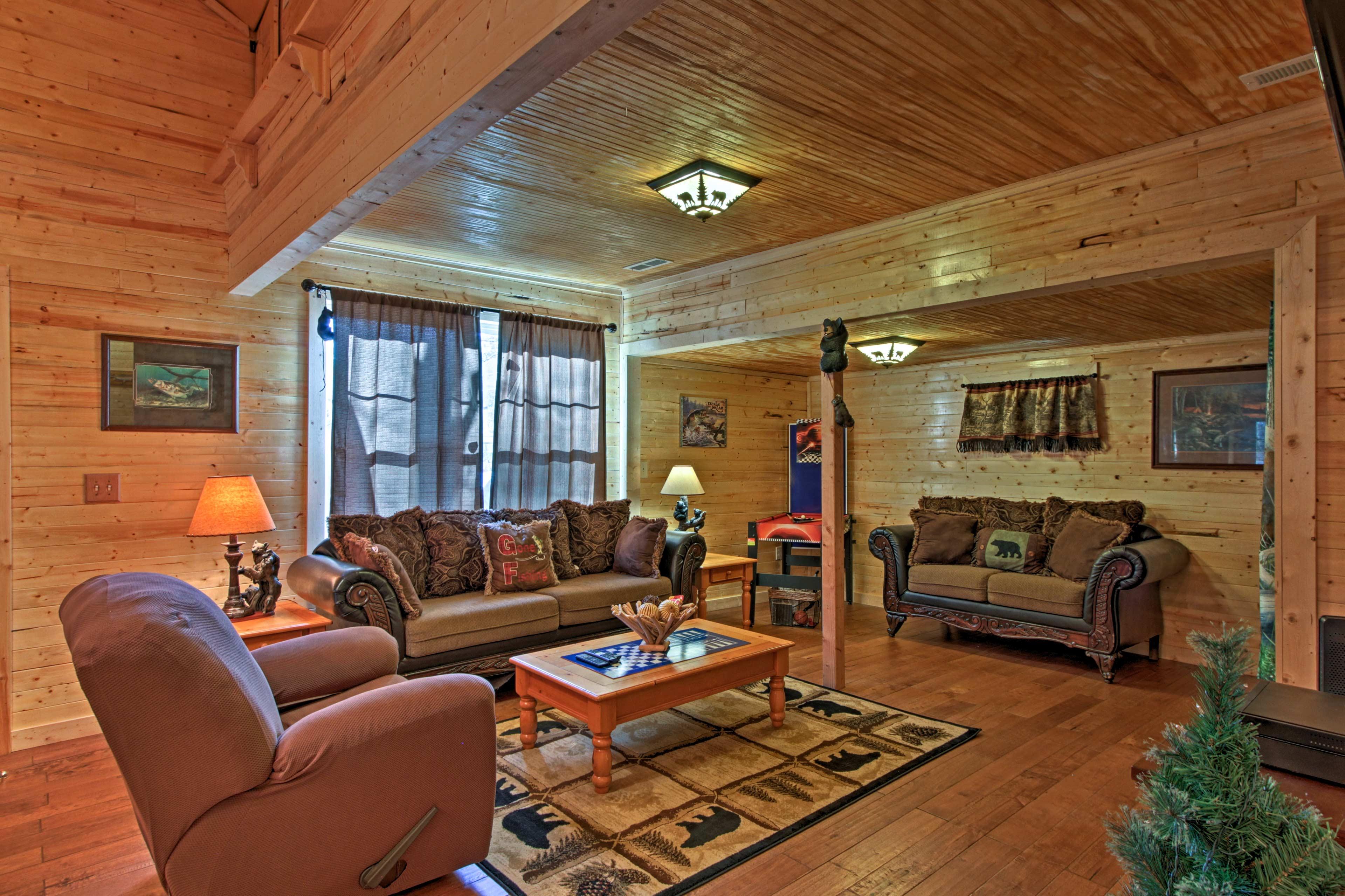 This 2-bedroom, 1-bathroom cabin in Sevierville comfortably sleeps 4.