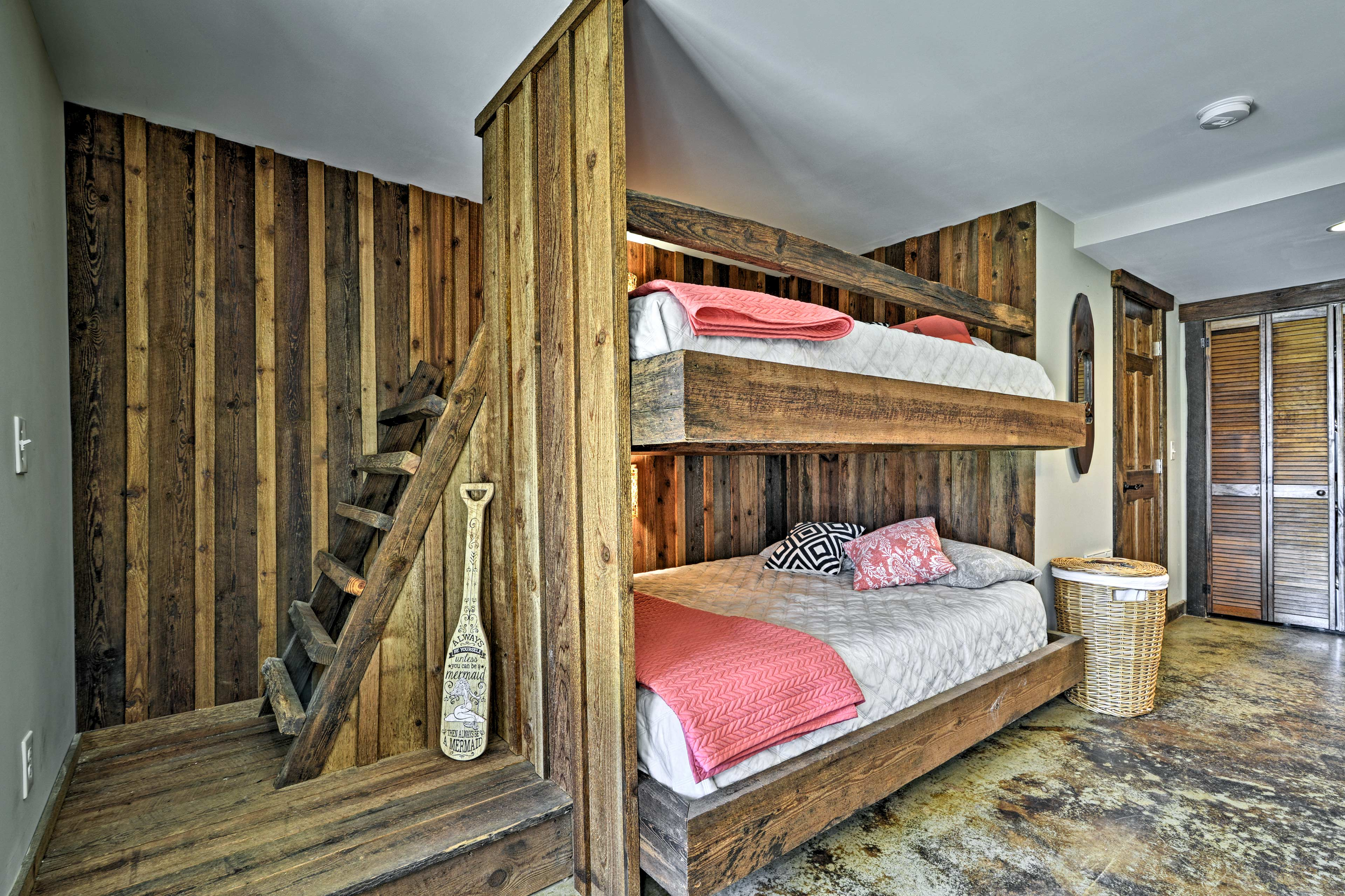 You'll find a set of built-in queen-over-queen bunk beds in this room.