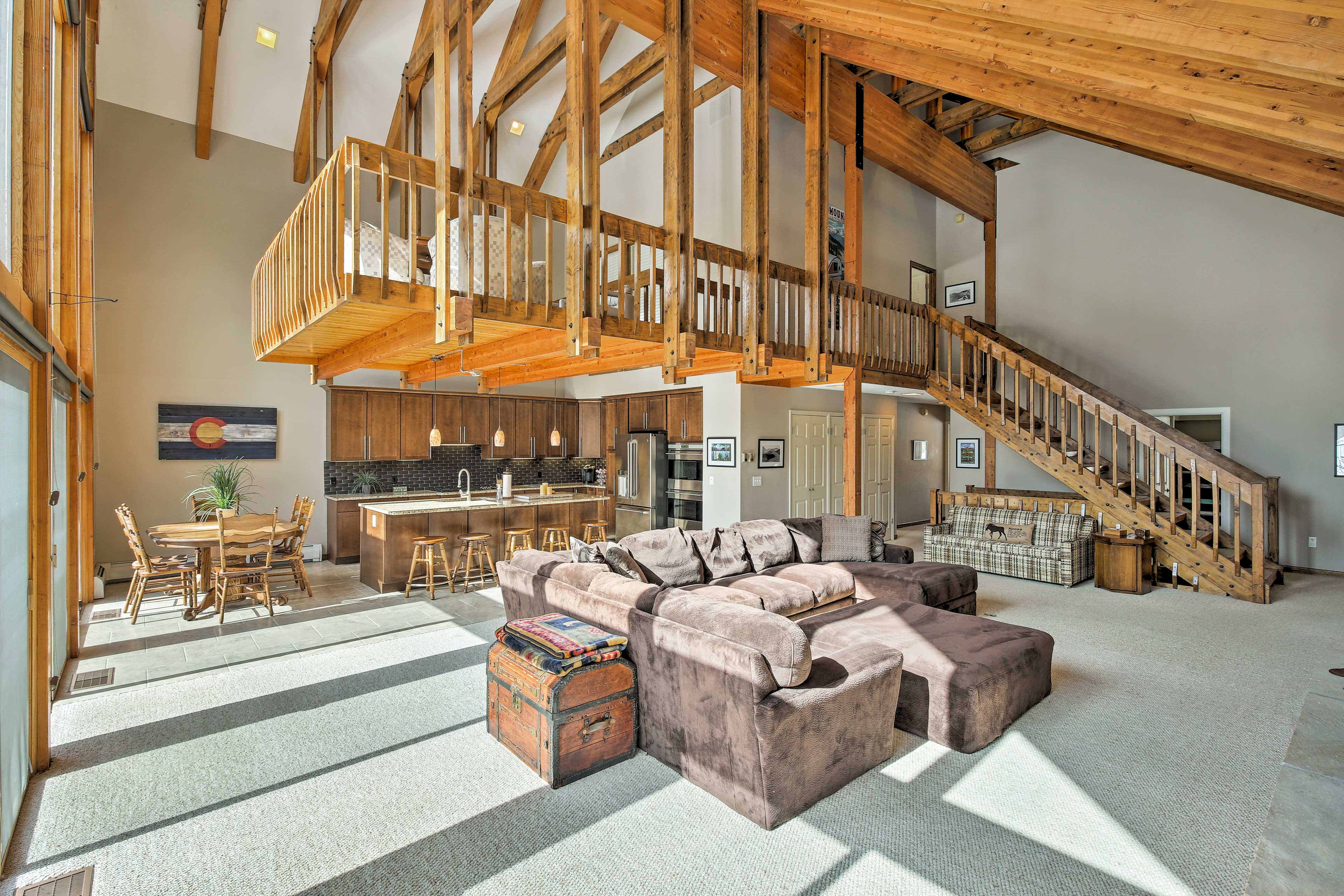 Beautiful exposed beams accentuate the soaring vaulted ceilings.