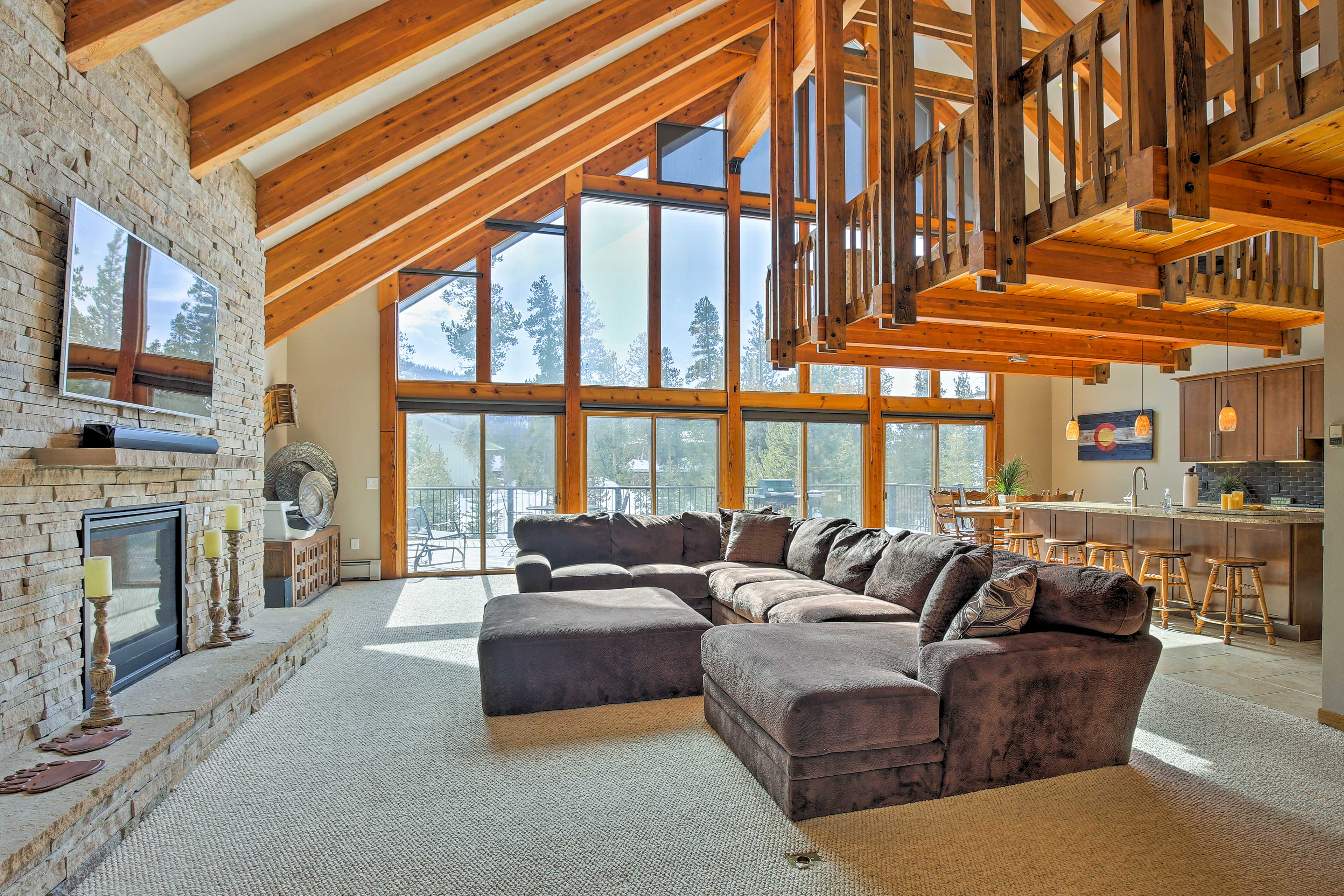 A two-story wall of windows floods the great room with natural light.
