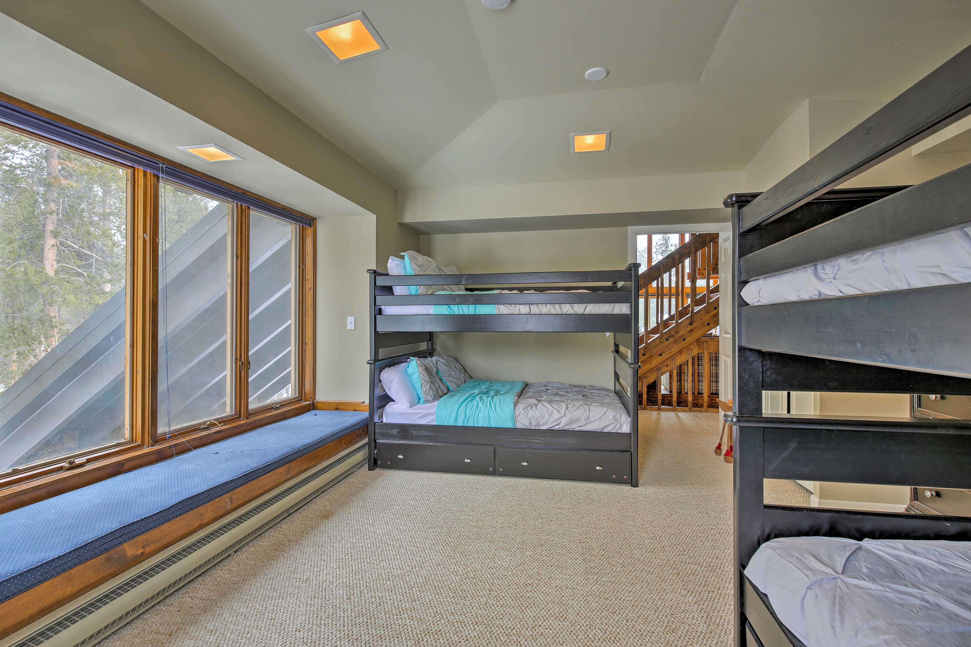 This bedroom features 2 full-over-full bunk beds and 2 twin trundle beds.