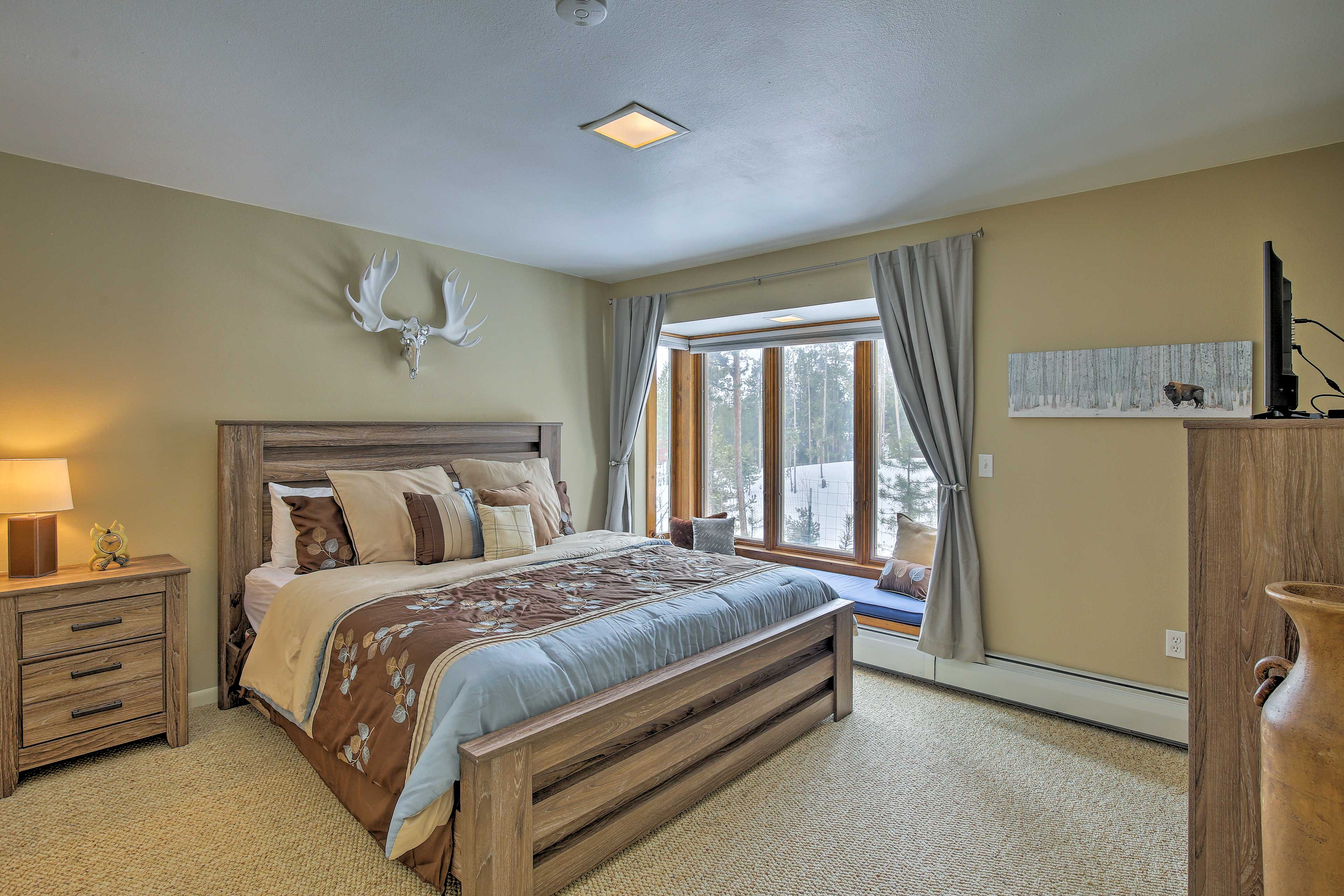 Drift off to dreamland in this plush king-sized bed.