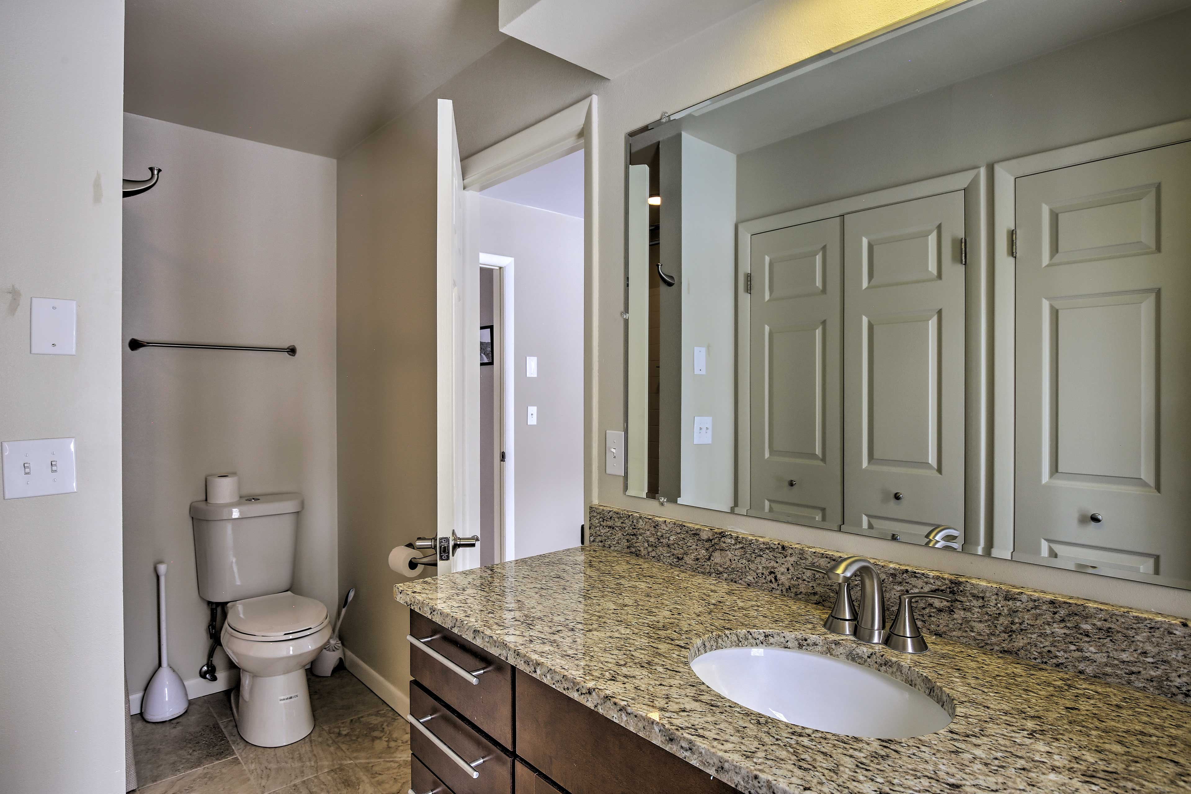 This first en-suite bathroom includes a tub/shower combo.
