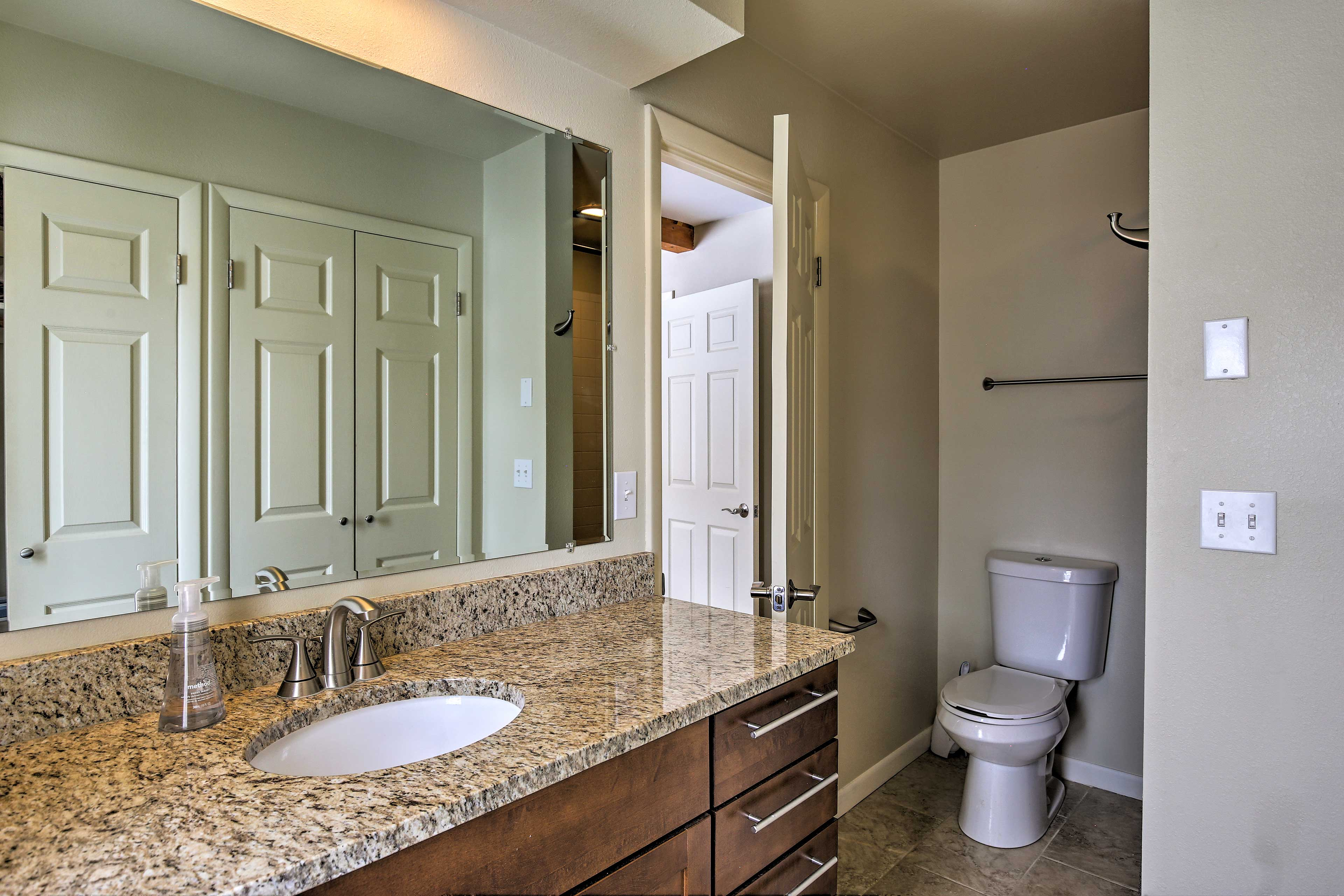 Closet storage is available in the bathroom.